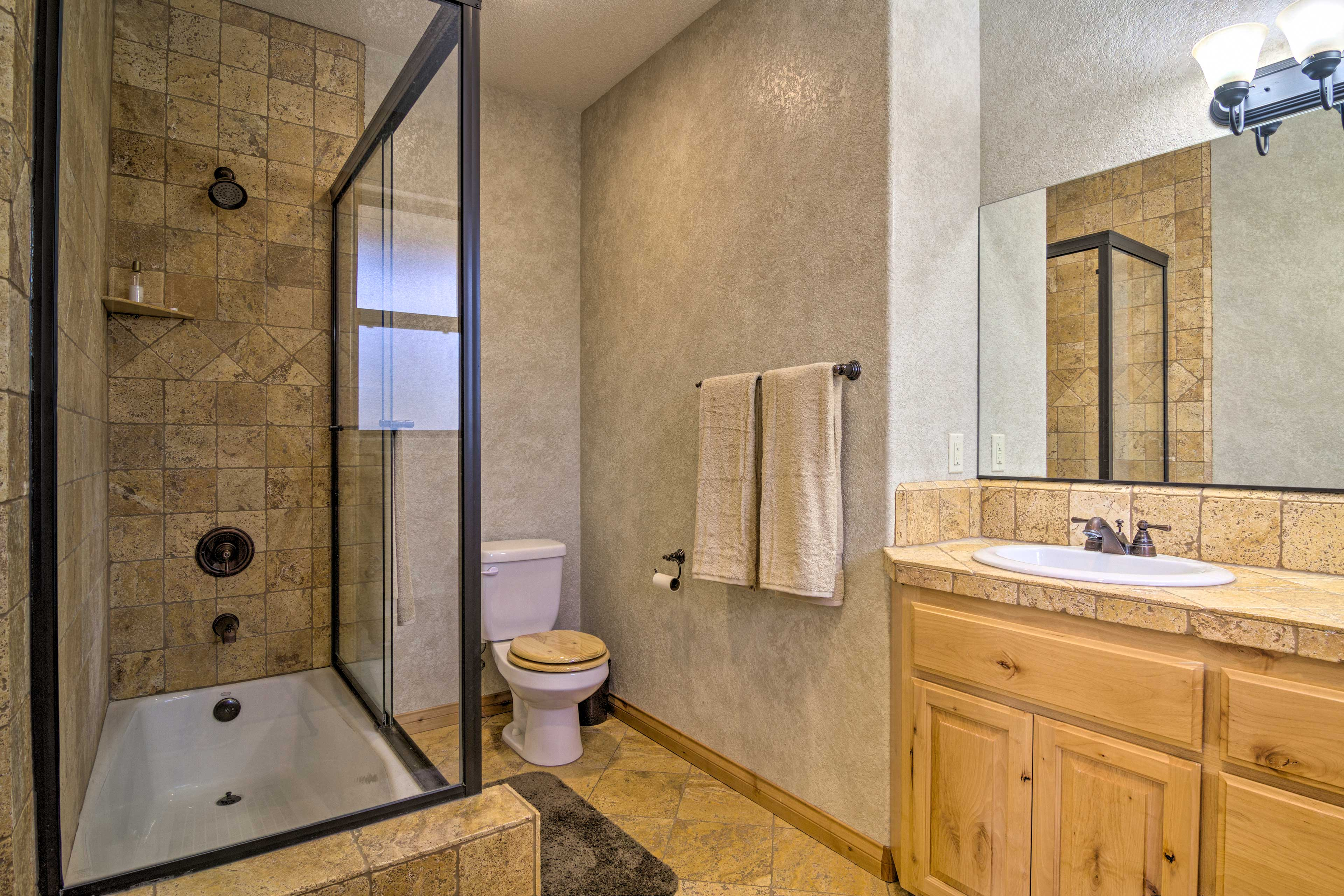 After a day outdoors, shower off in this bathroom.