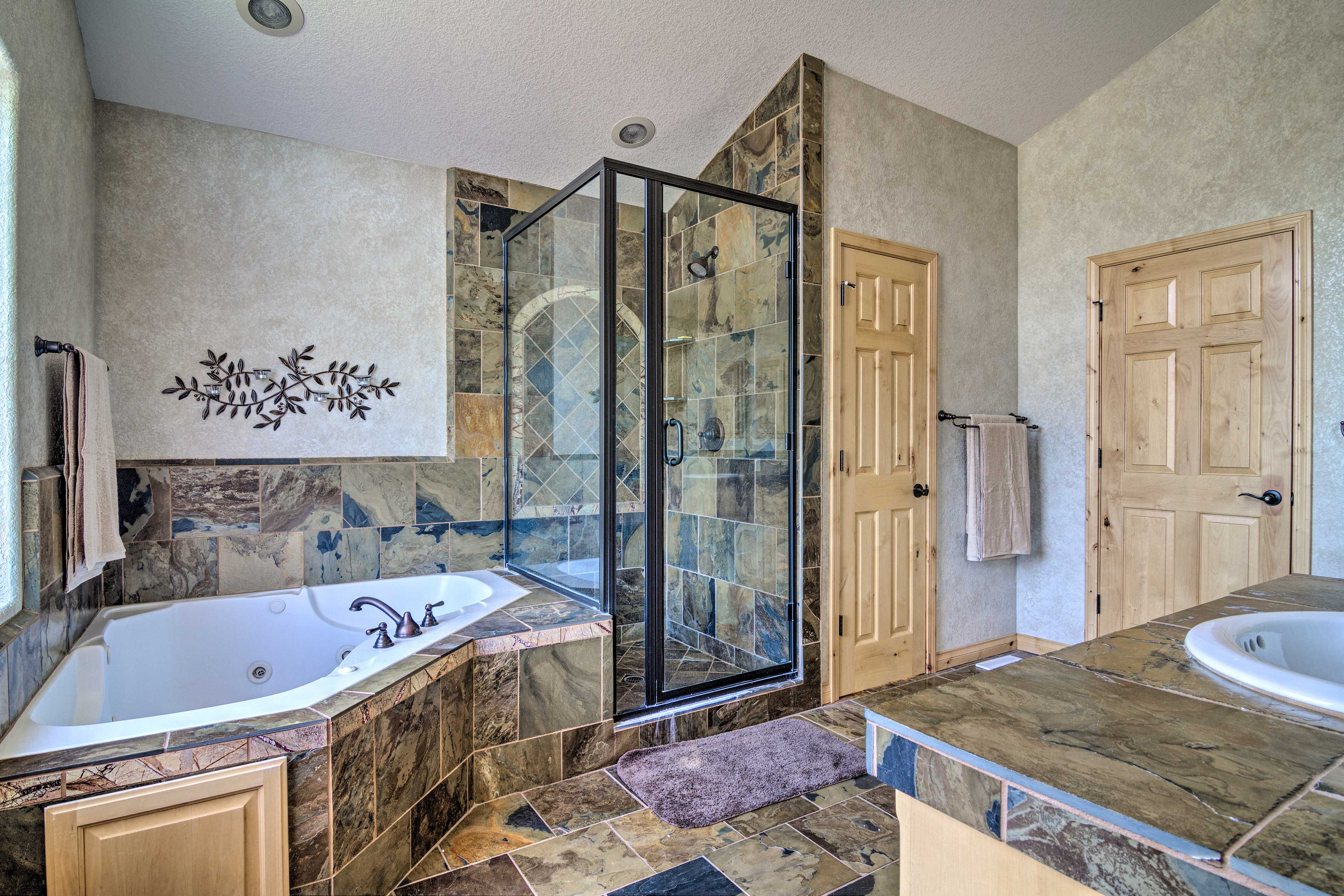 After a day outdoors, shower off in the lavish master bathroom.