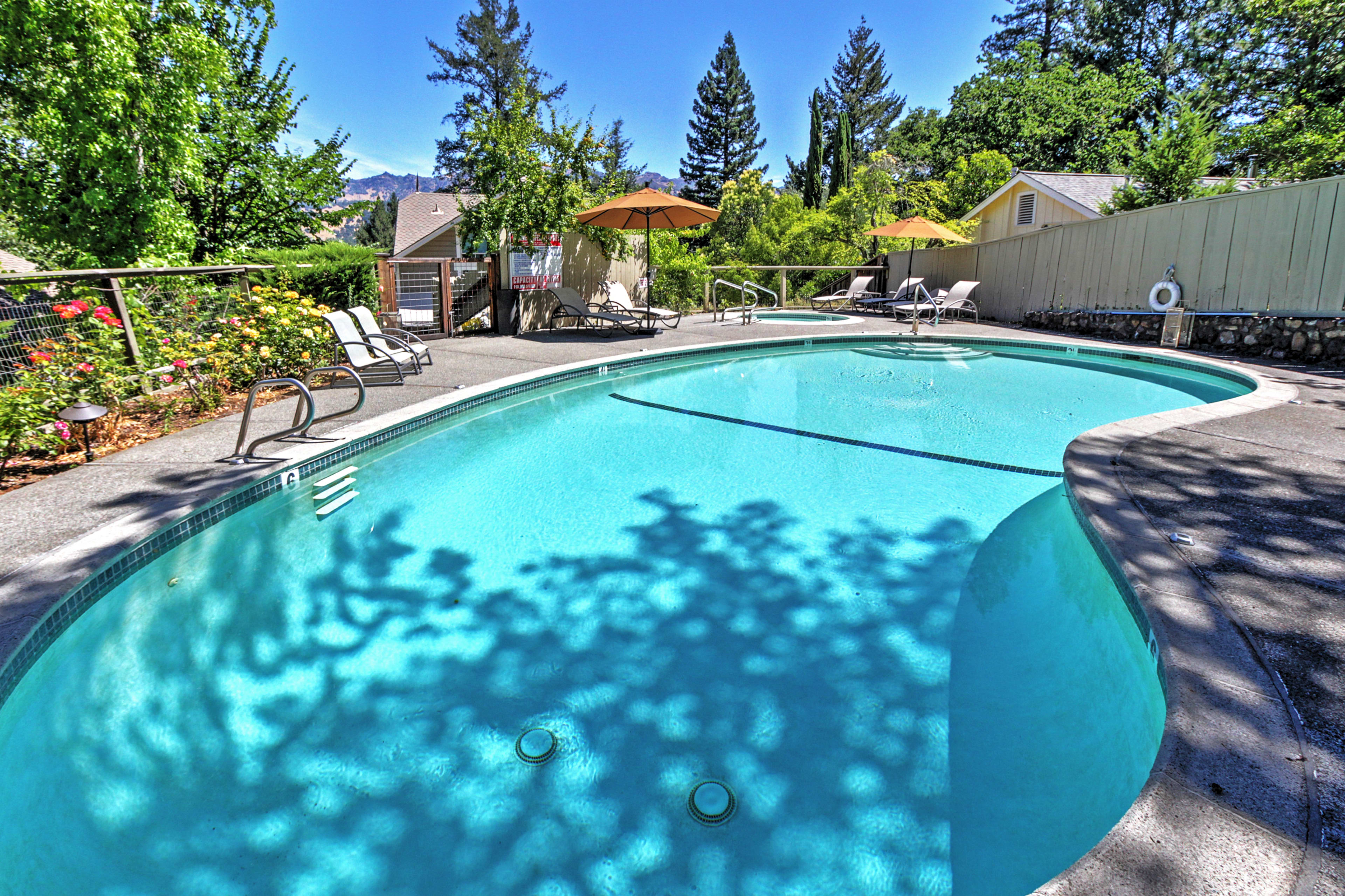 The picturesque exterior space features a private pool, hot tub and courtyard.
