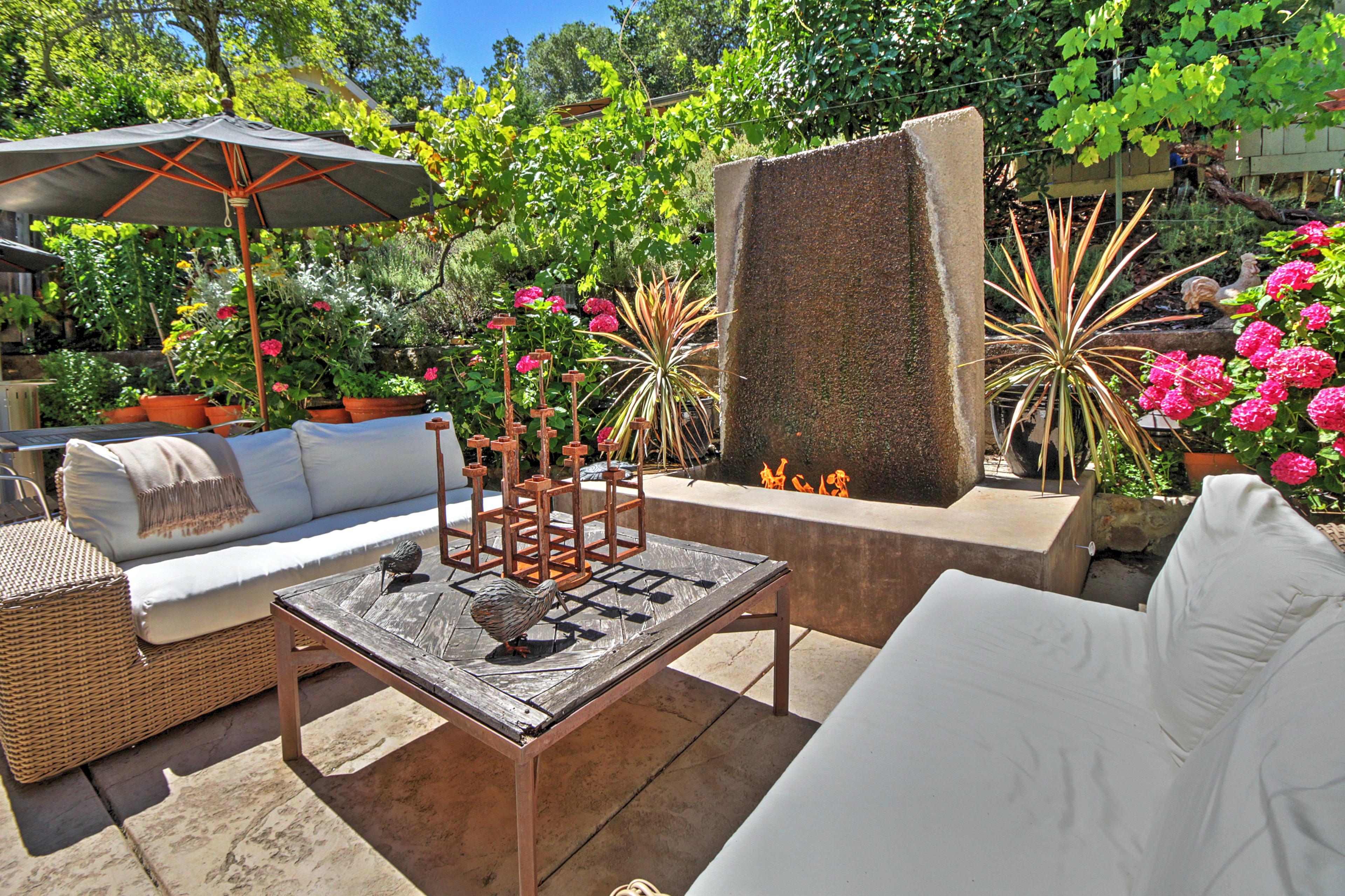 Unwind with your travel companions by the stunning outdoor fireplace.