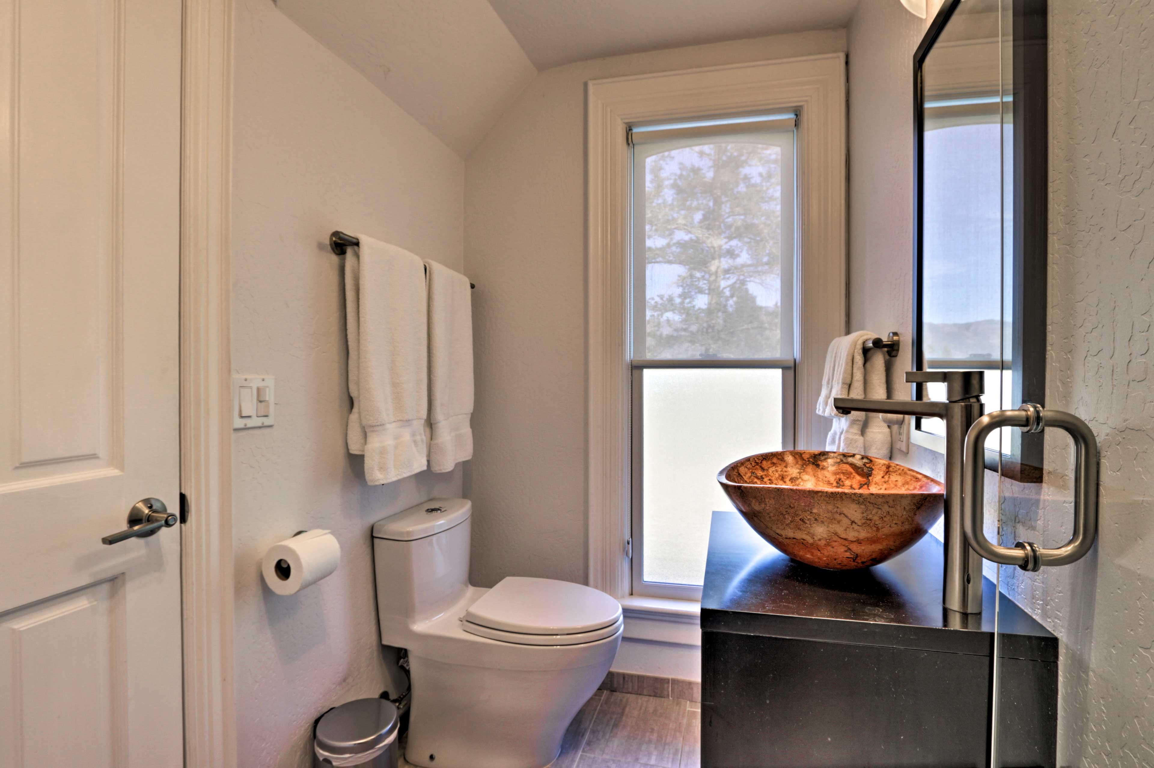 Several bathrooms provide plenty of privacy.