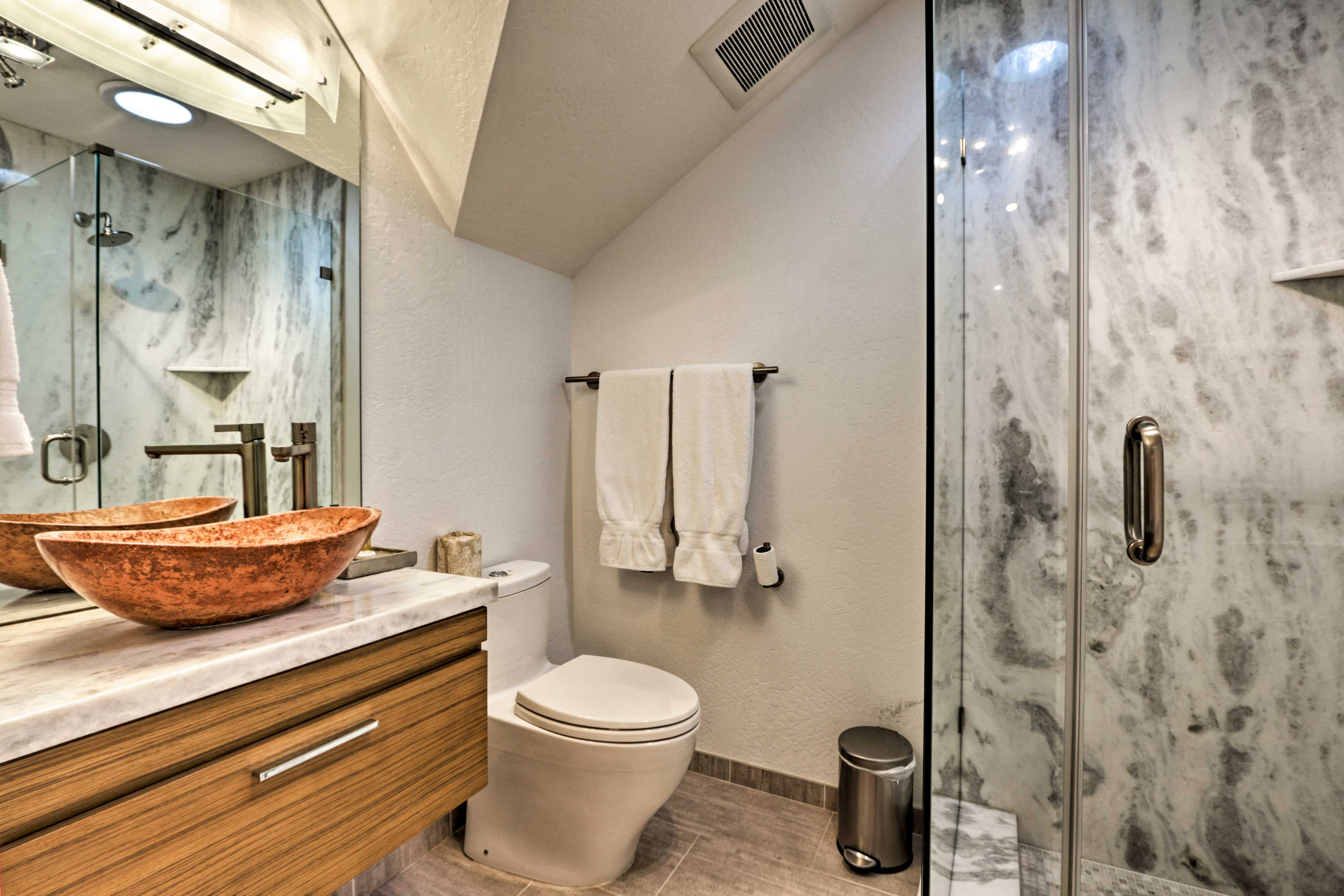 This pristine bathroom also includes a walk-in shower.