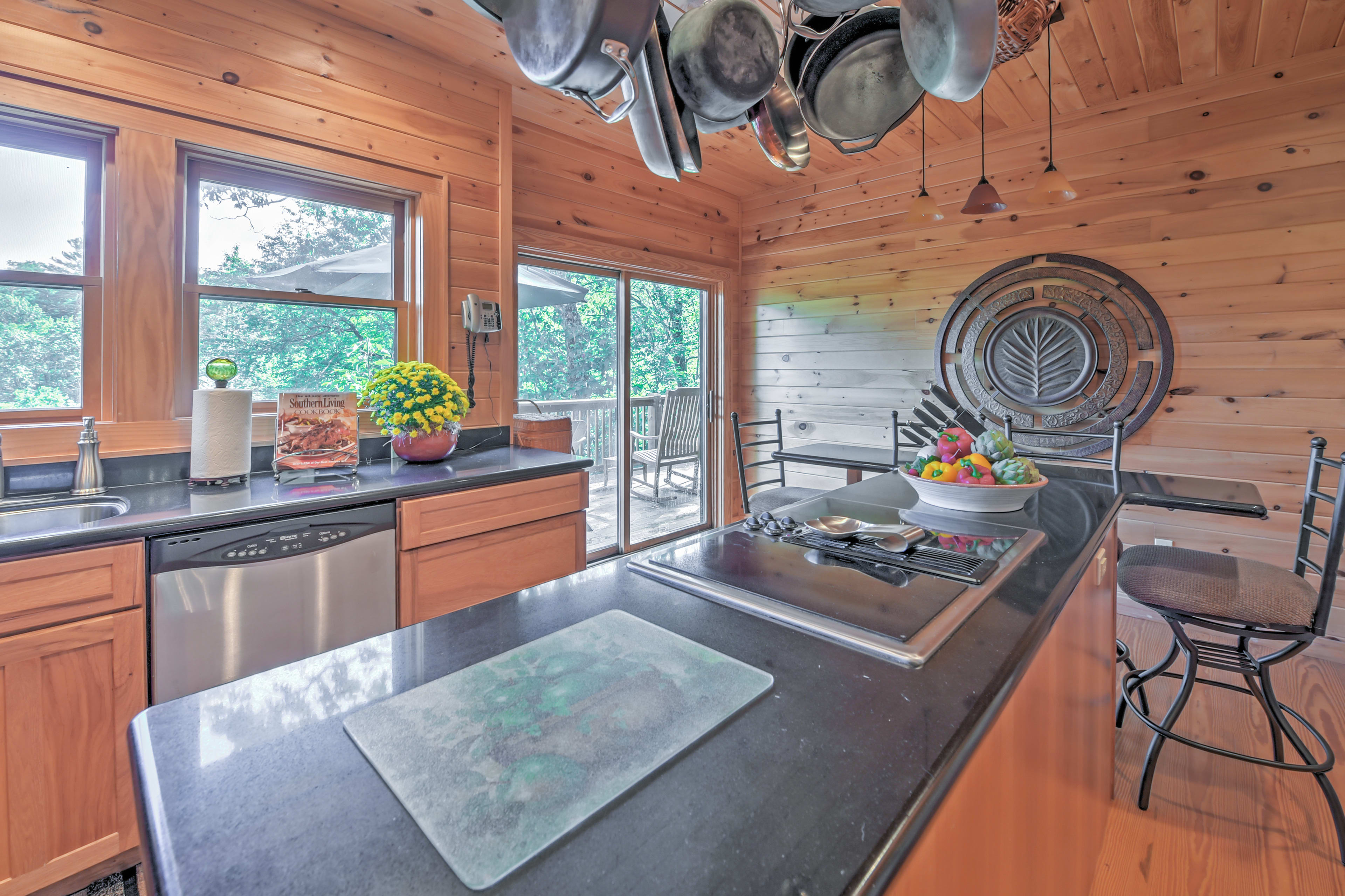 An expansive fully equipped kitchen has everything you'll need to whip up meals.