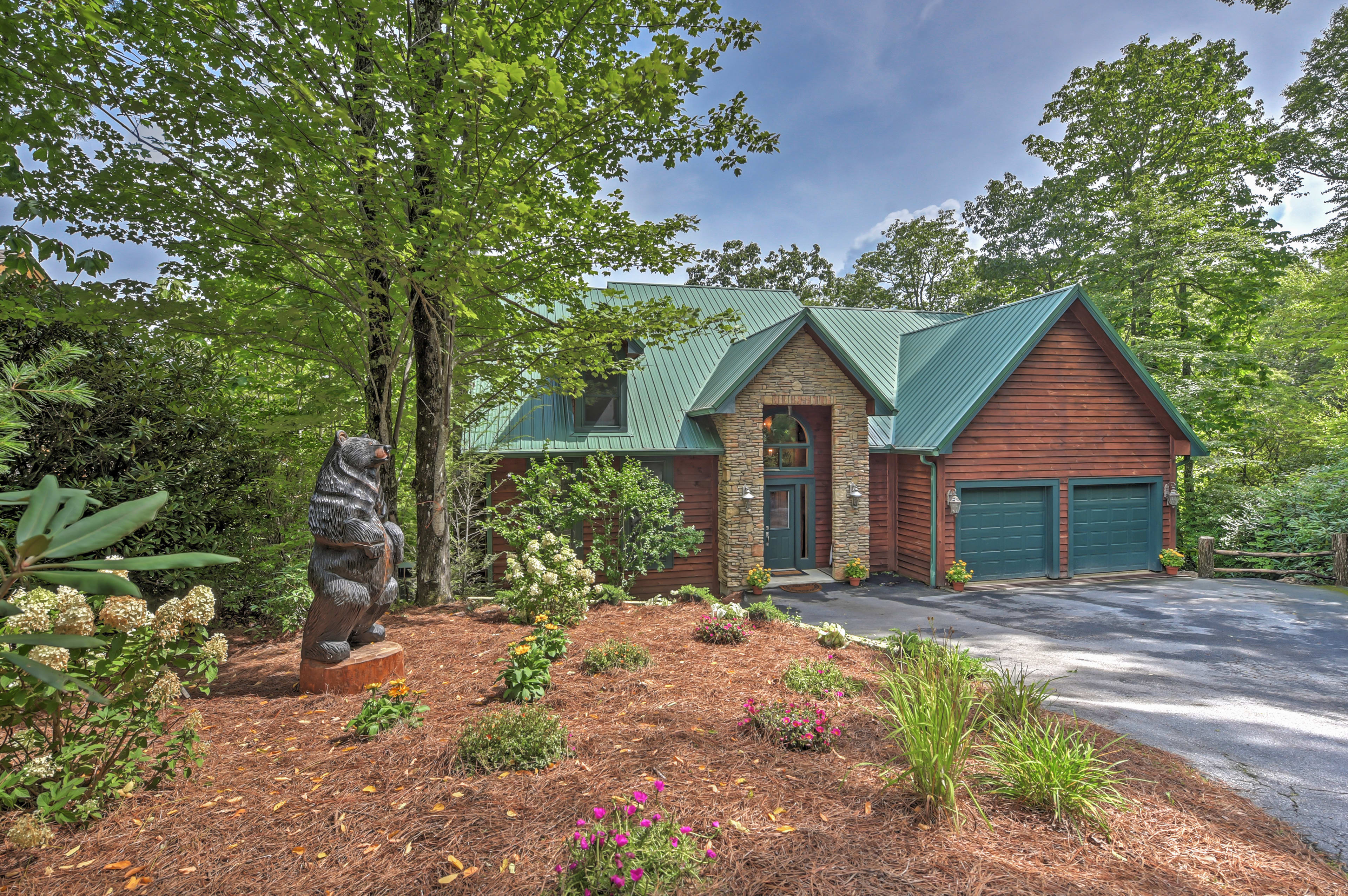 Tucked away in the woods, this property will help you feel away from it all.