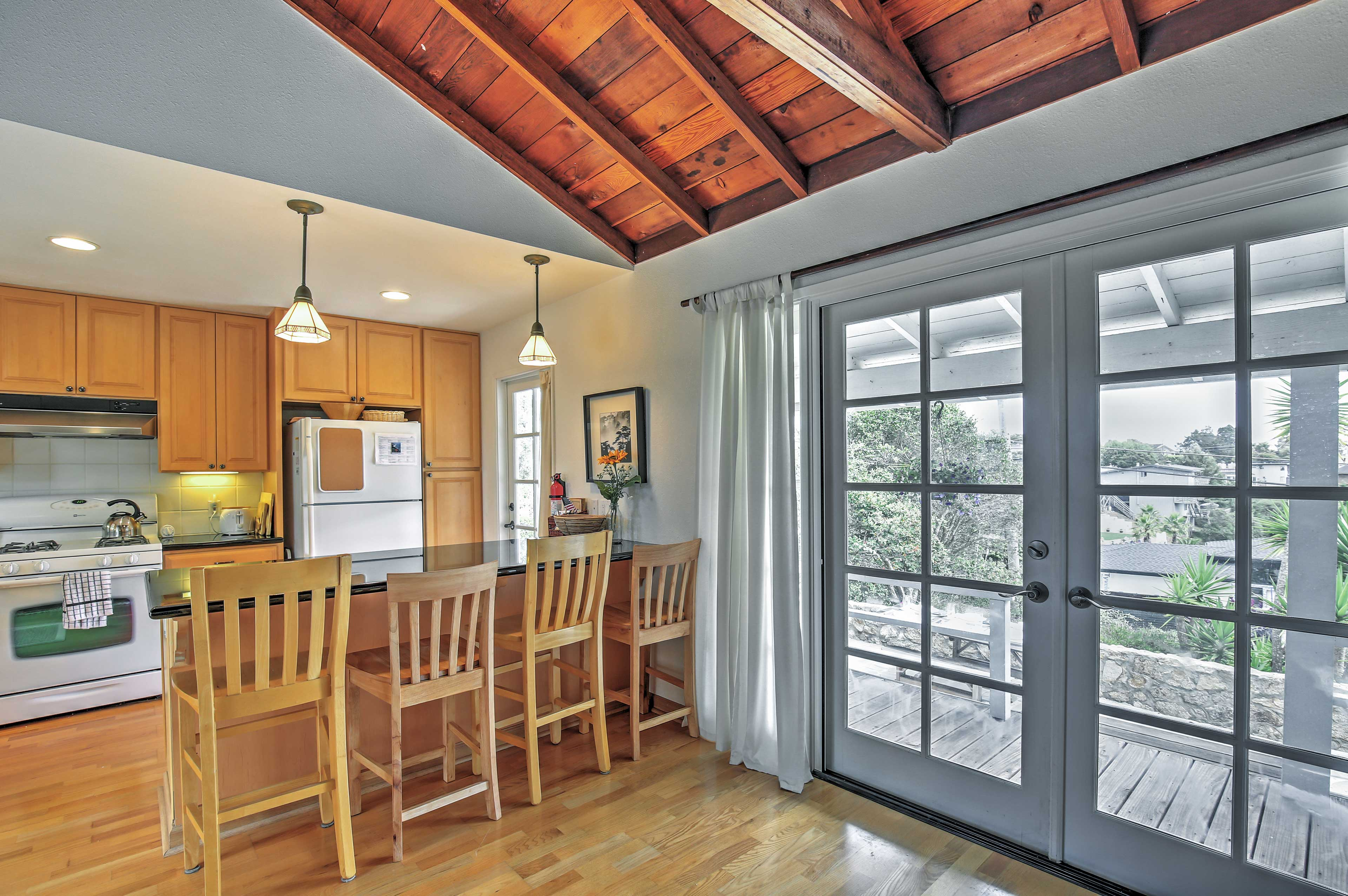 You'll love the character of this 1940's cottage with vaulted cedar beam ceilings.