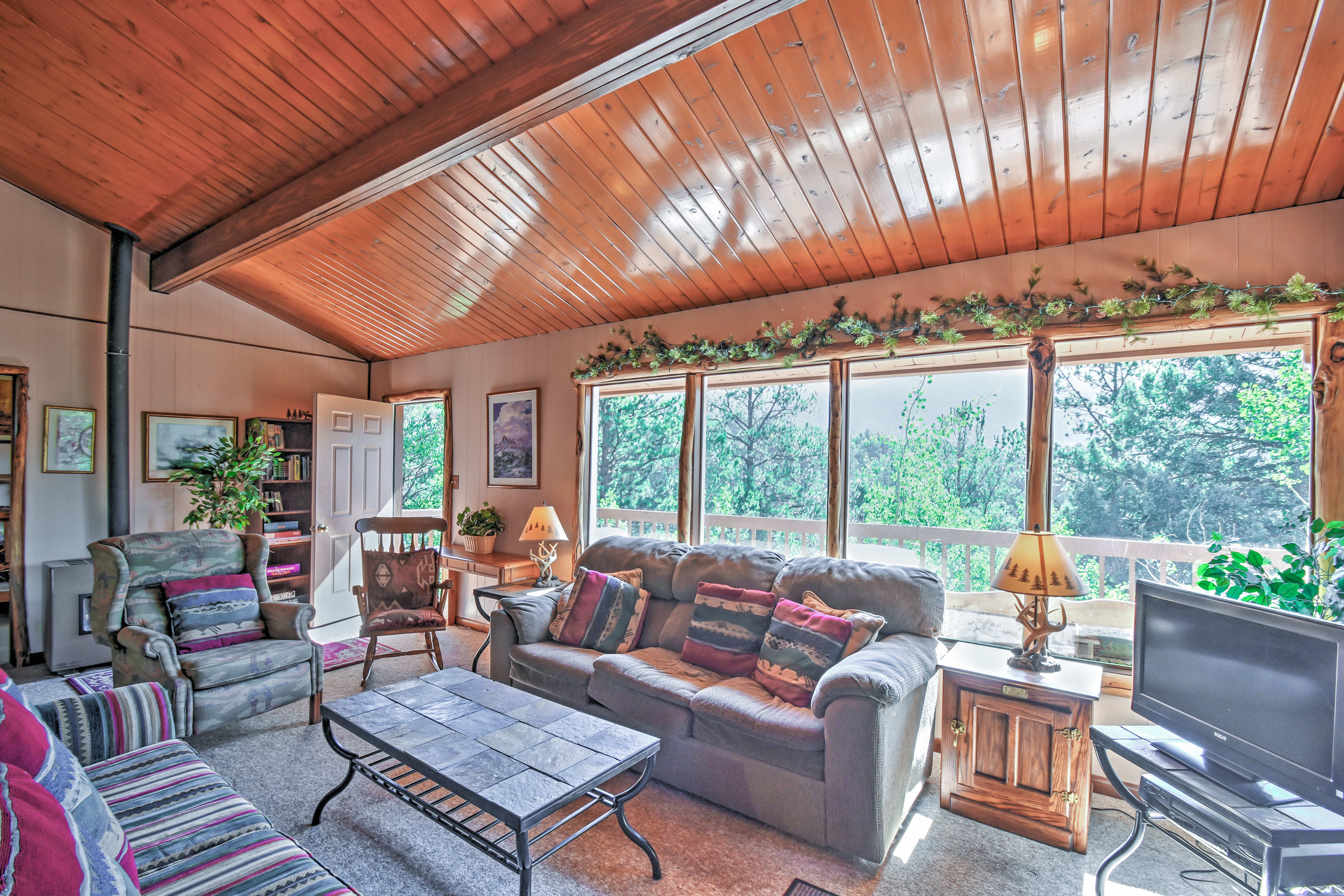 Enjoy marvelous wooded views from the expansive windows.