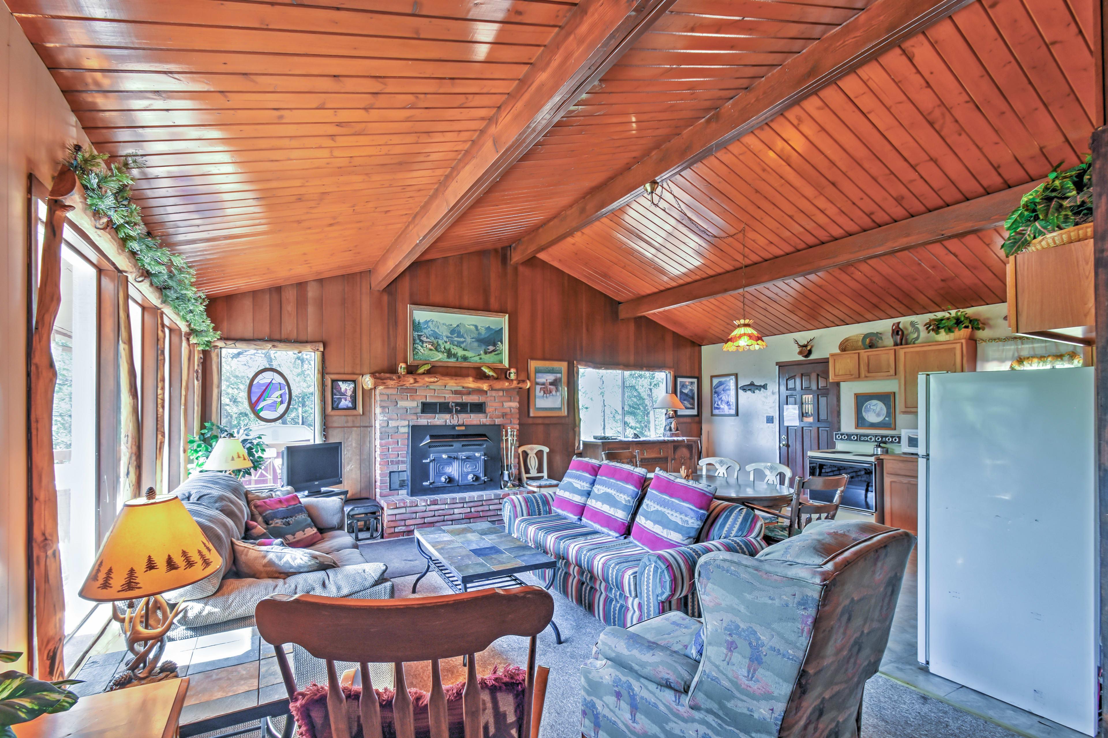 Unwind around the cozy wood-burning fireplace.