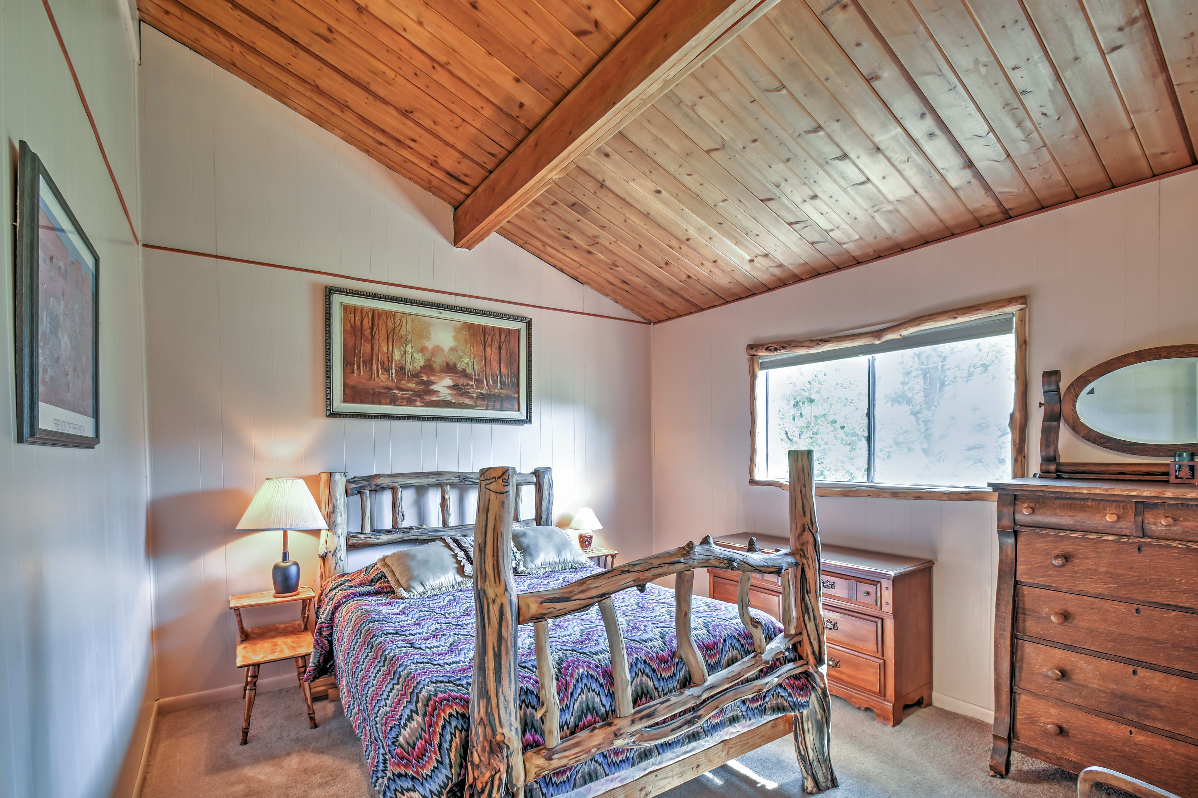 Curl up in this queen bed after your mountain adventures.