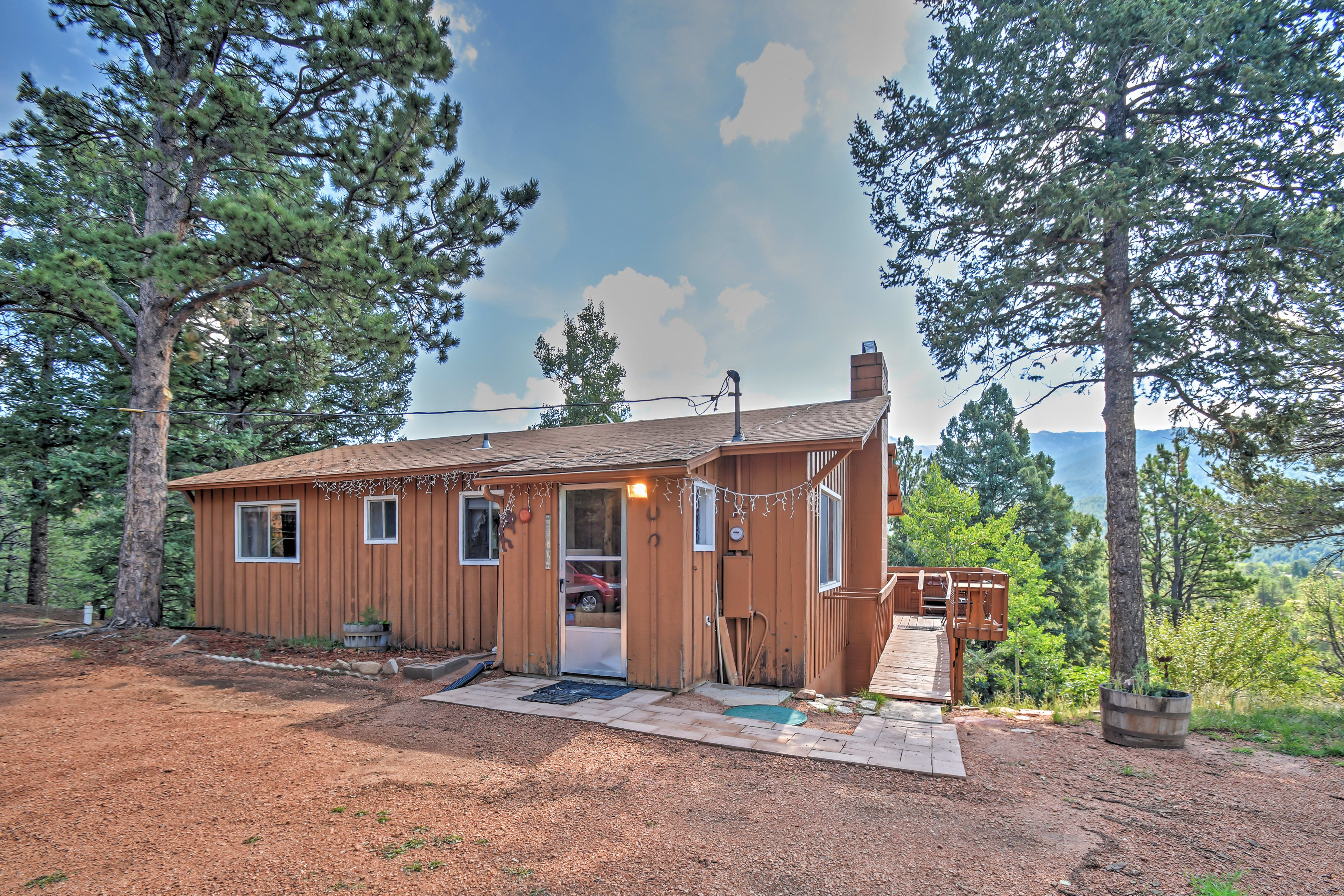 'Horseshoe Lodge' is a secluded Divide cabin surrounded by towering trees.