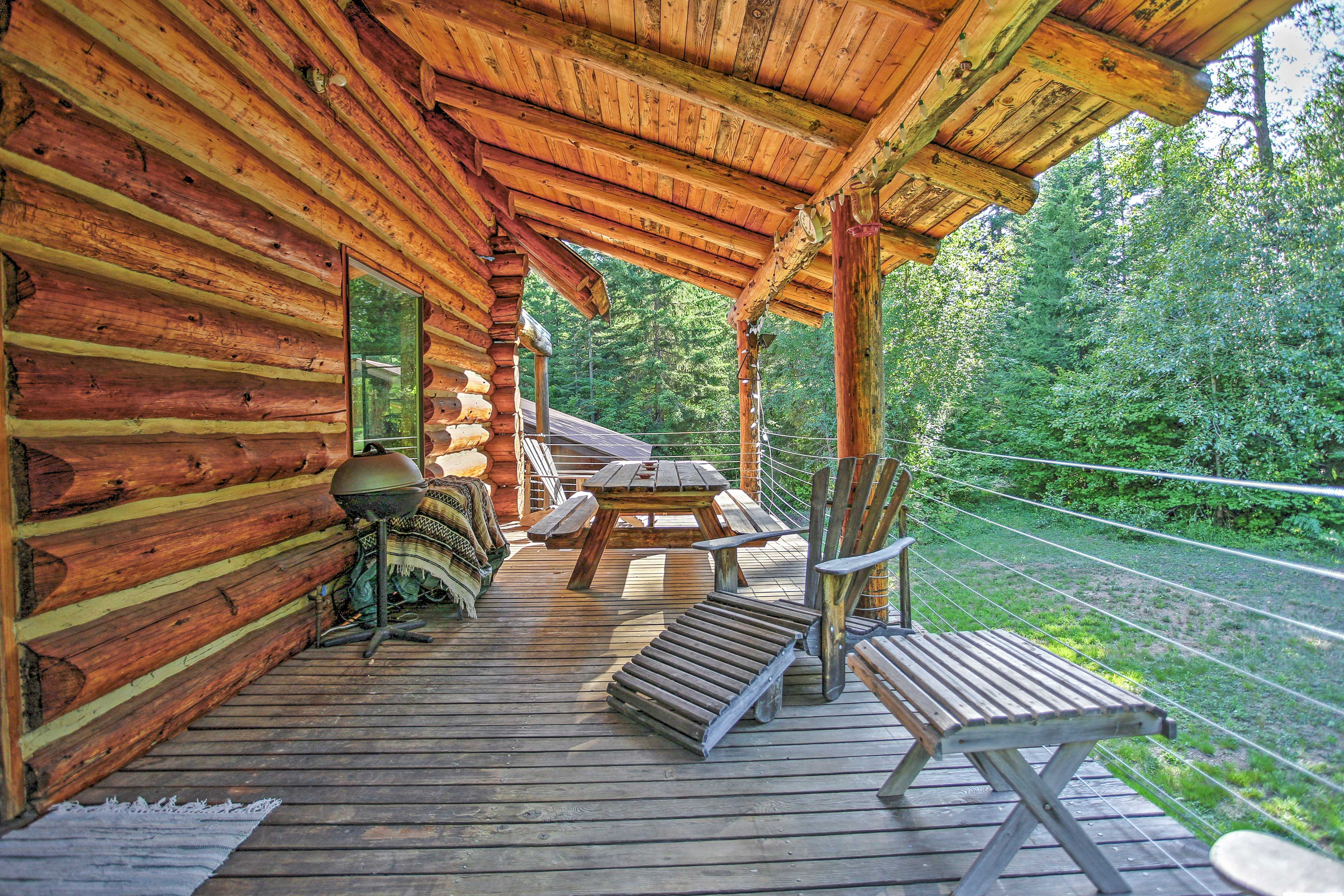 Head out to the private furnished deck to admire the forest views!