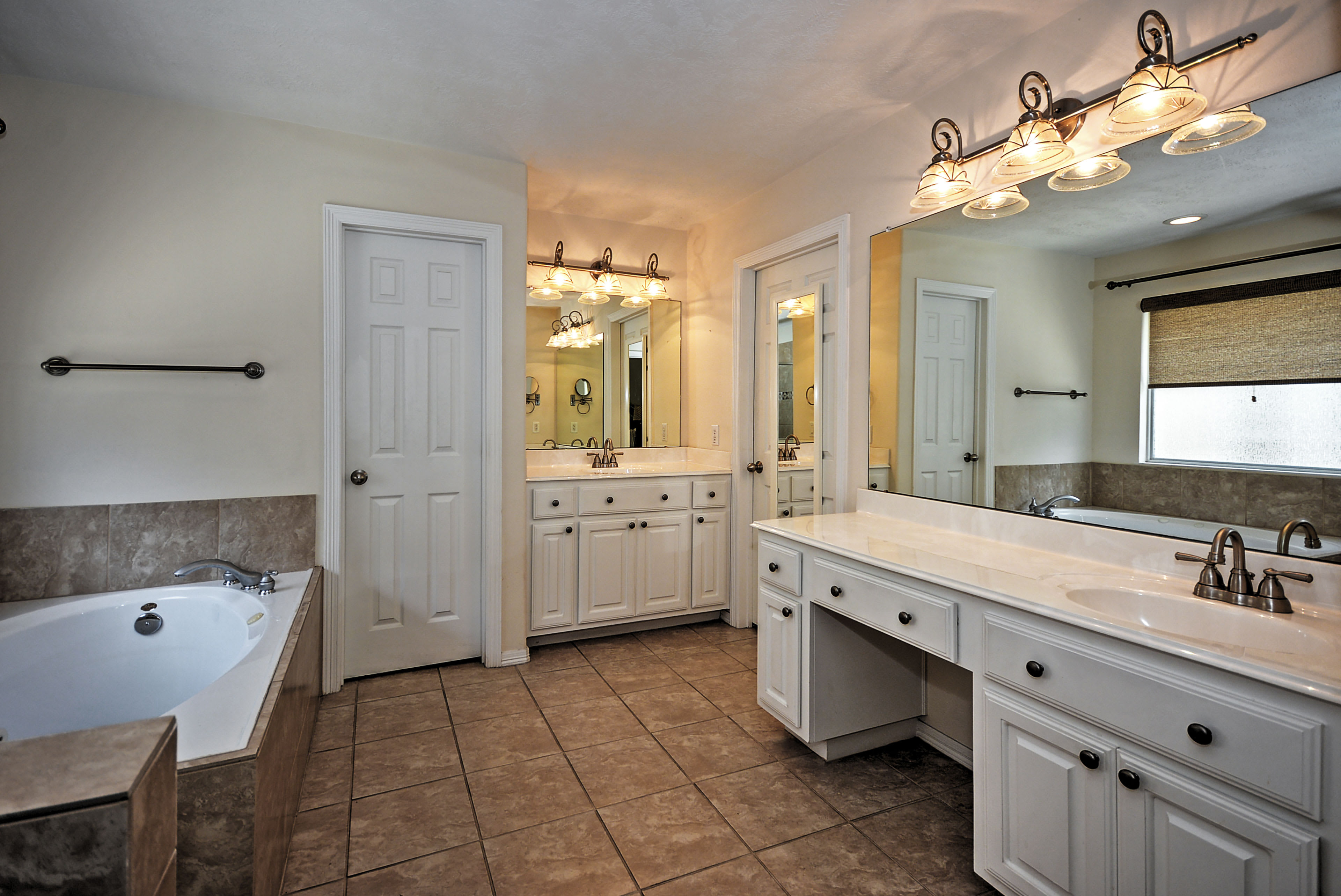 The master bathroom is both spacious and luxurious.