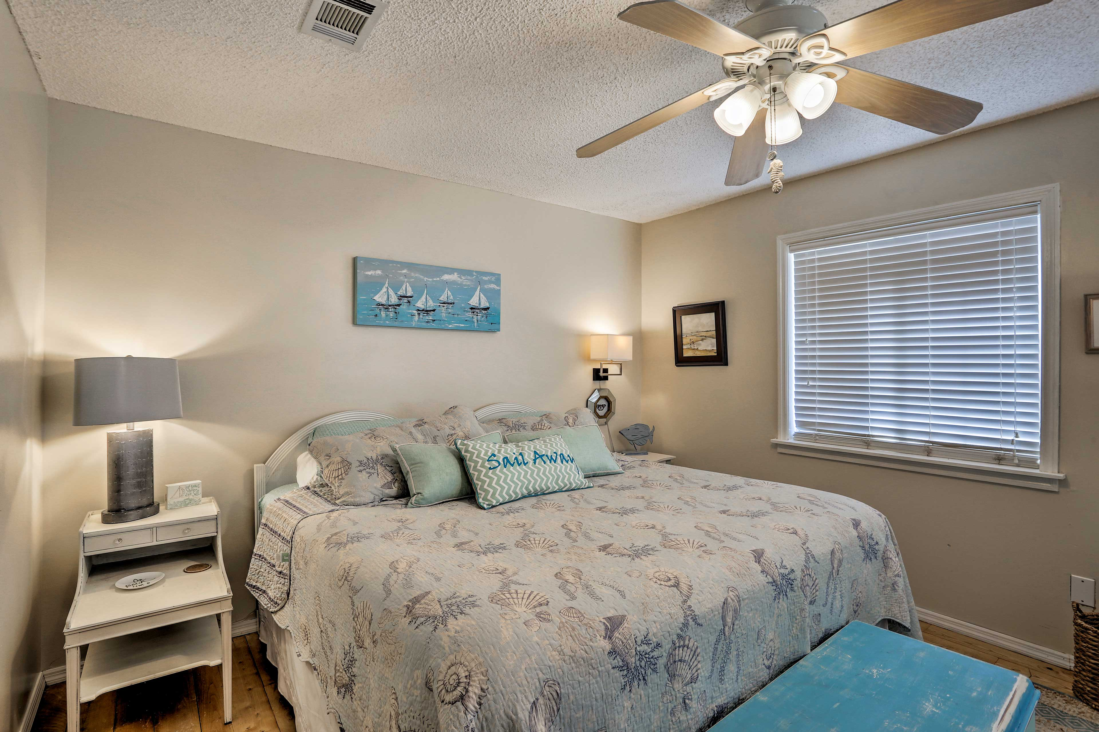Recharge with a power nap on the plush king-sized bed in the master bedroom