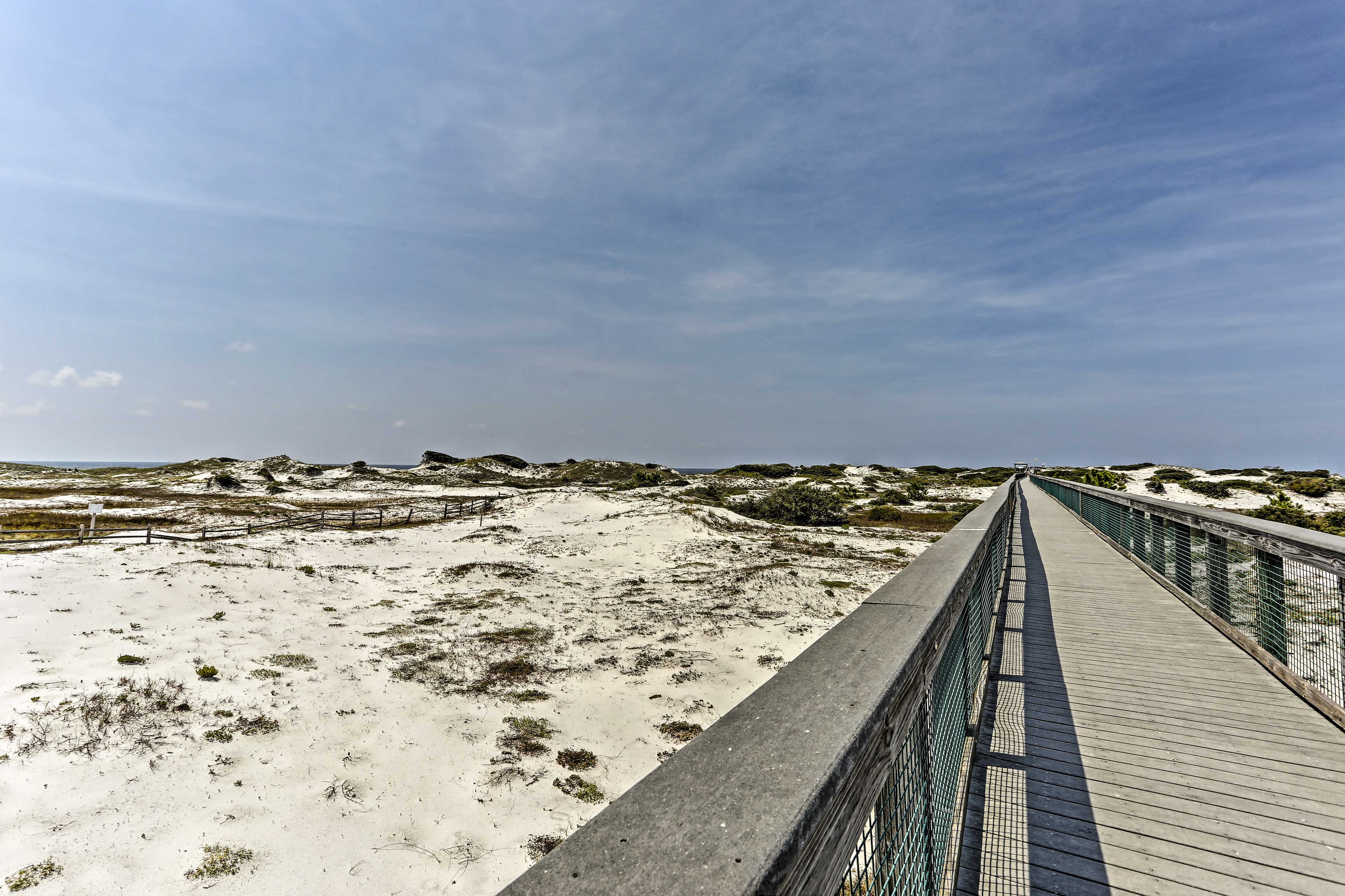 Stroll down to the water through the scenic sand dunes.