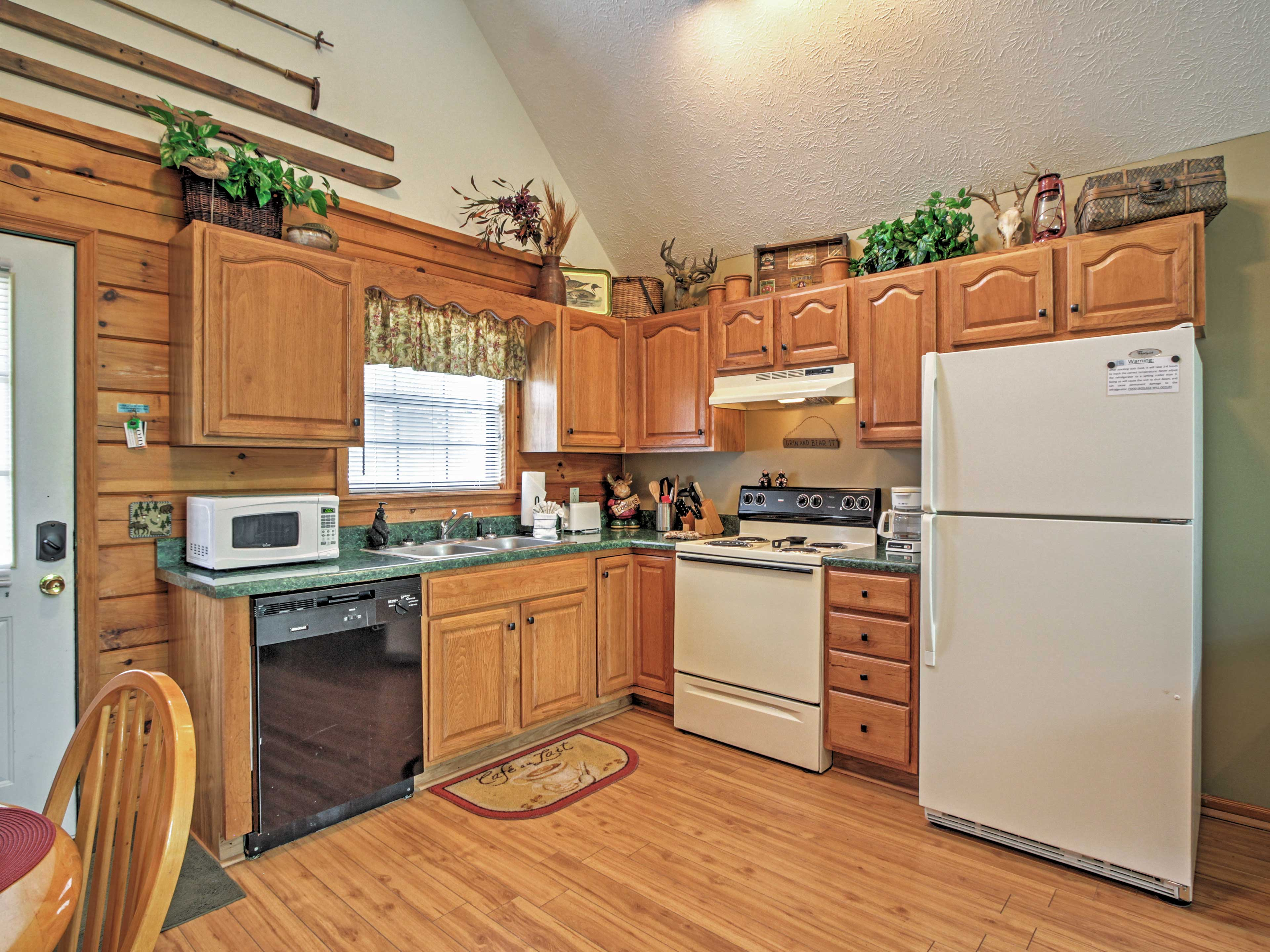 The living and dining areas open freely to the fully equipped kitchen.