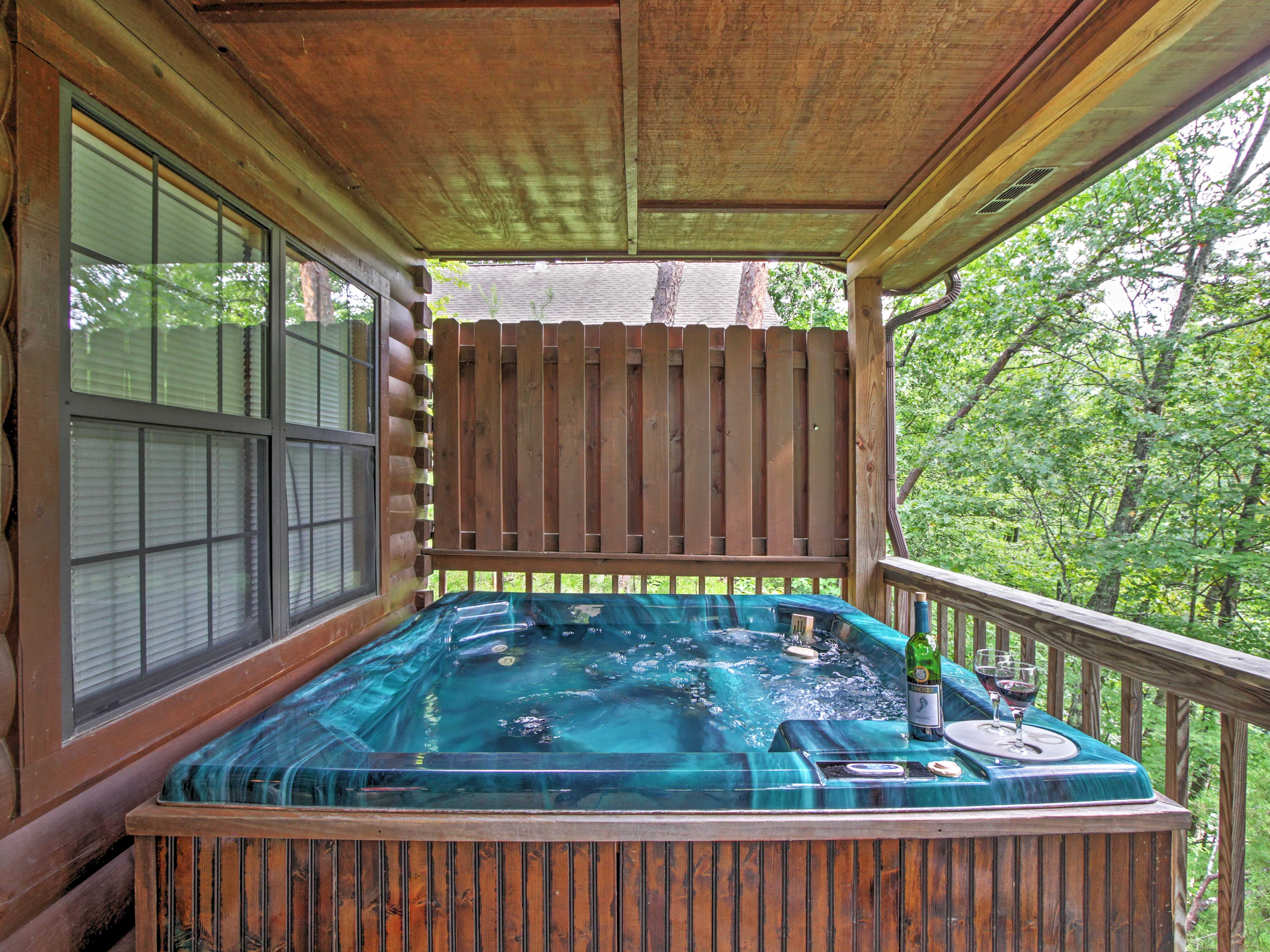 Unwind in the soothing warmth of the private hot tub.