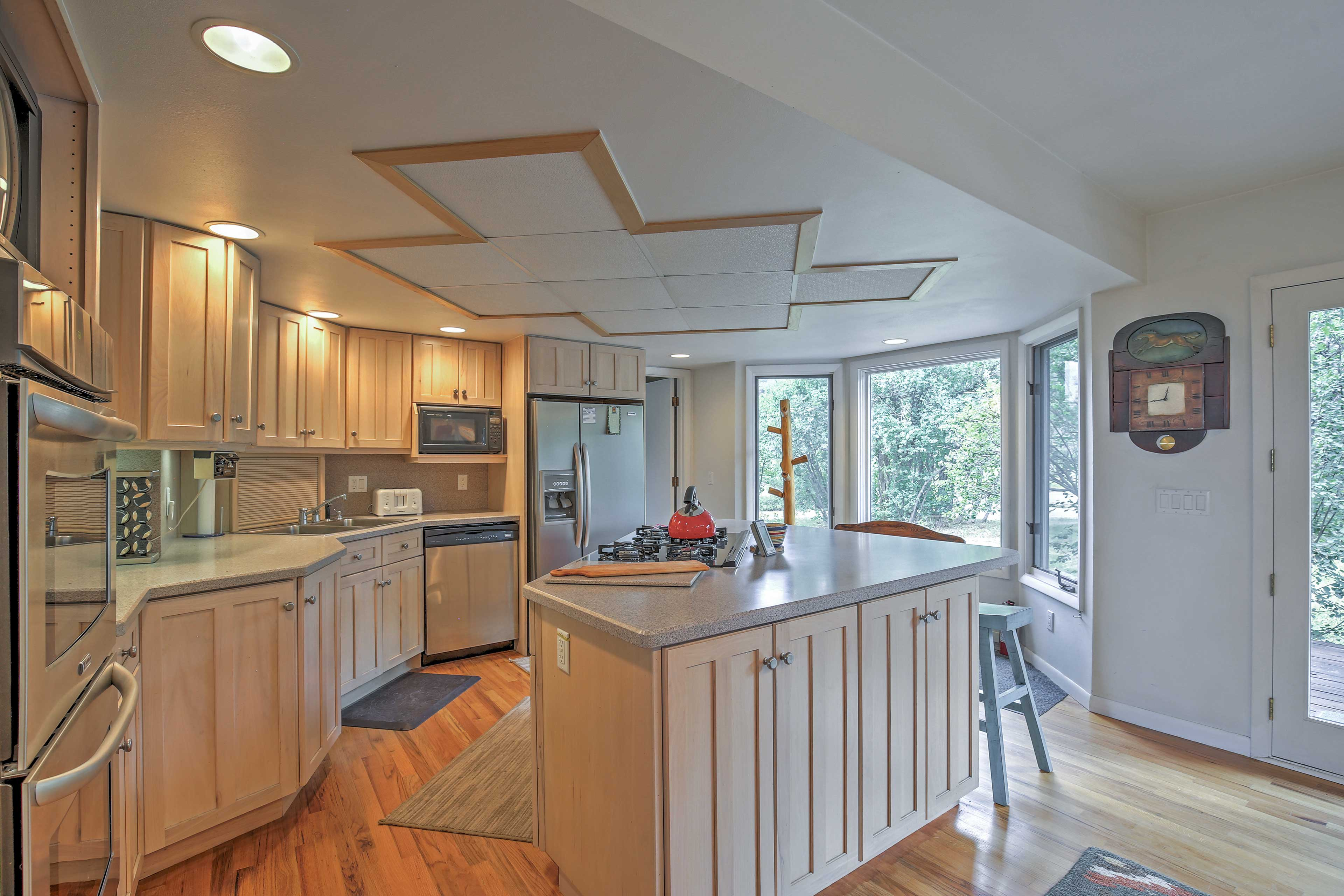The kitchen offers ample space with a large kitchen island.