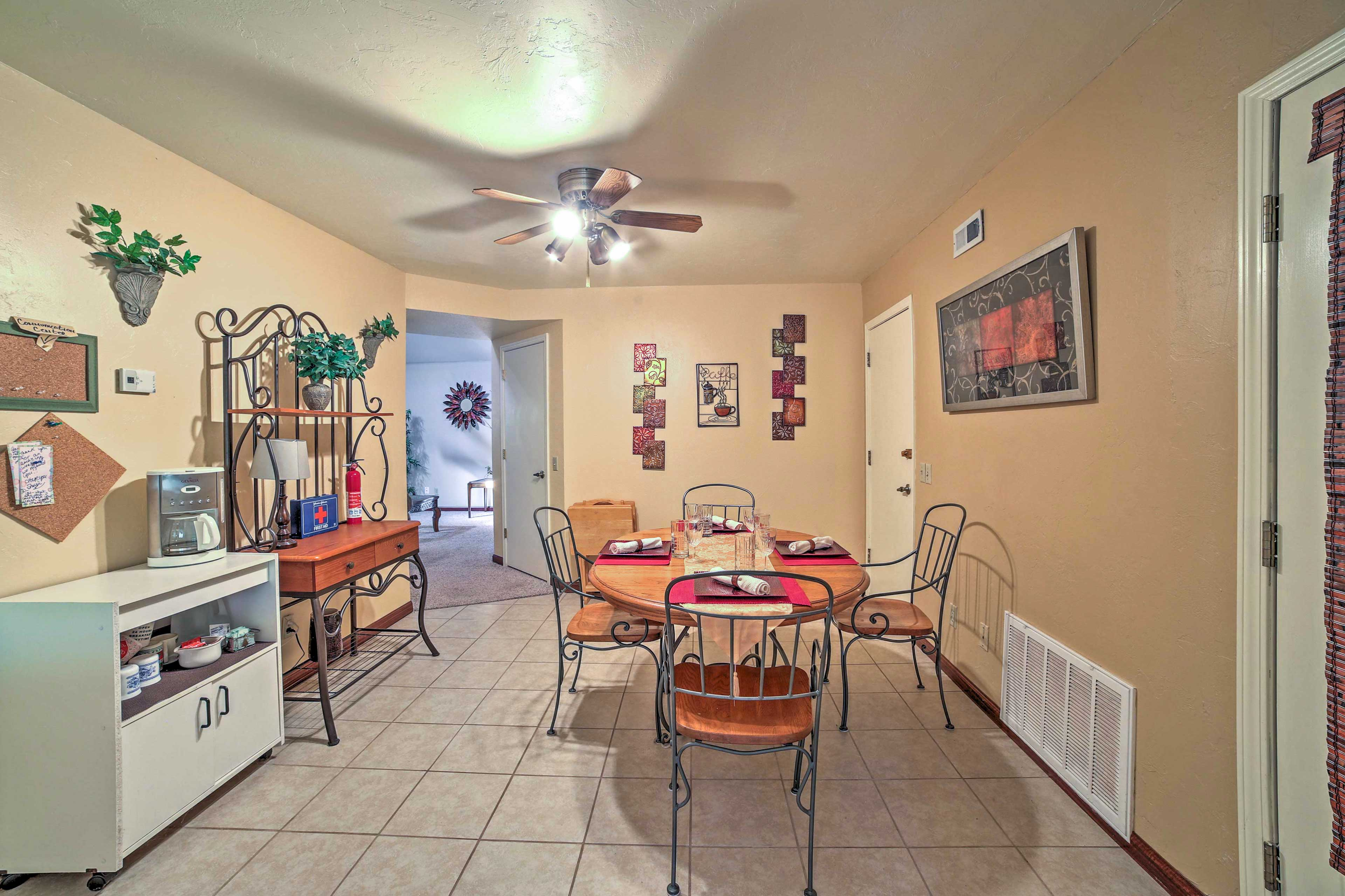 The dining area is adorned with charming art & wall decor.