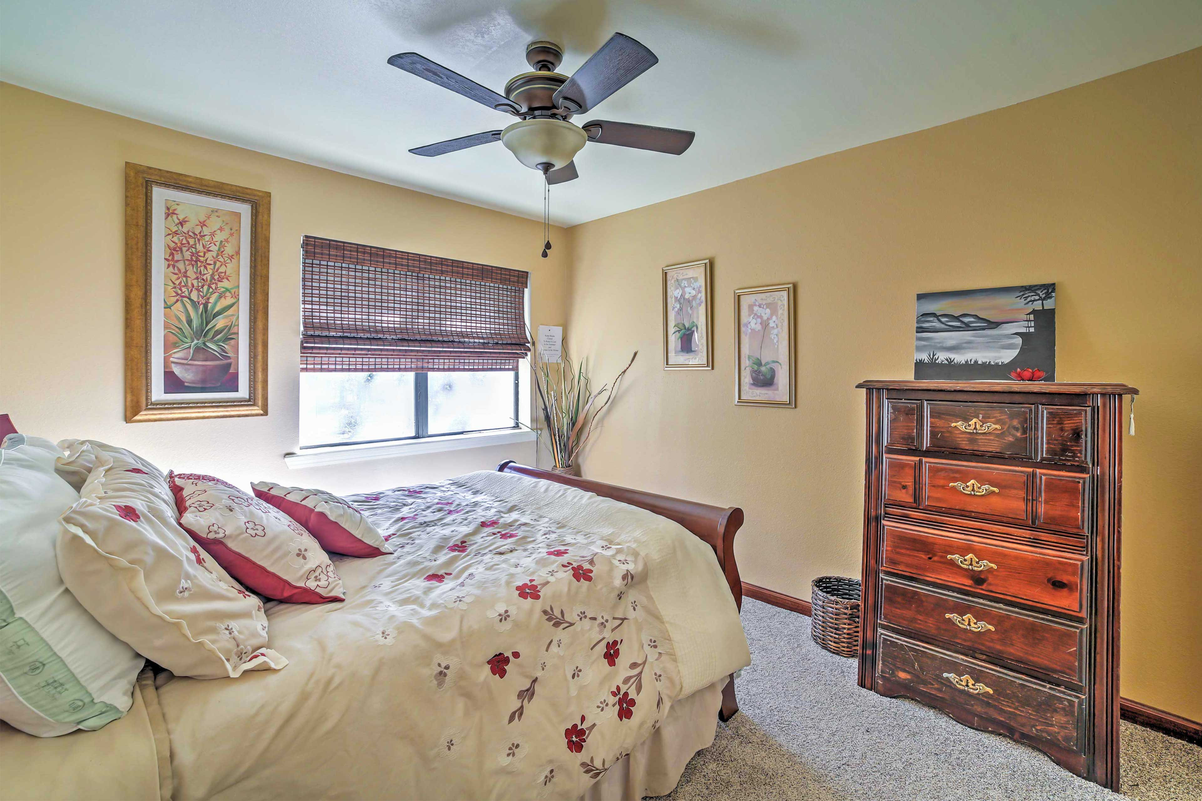 With the vintage dresser & abundance of pillows, sleep in style in this room!