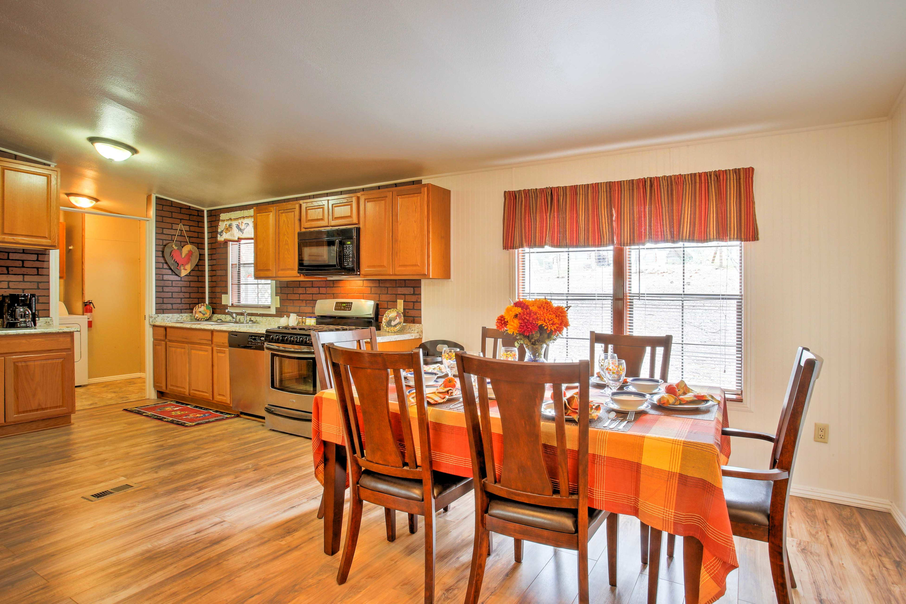 The dining table adjacent to the open kitchen has seating for everyone in your group.