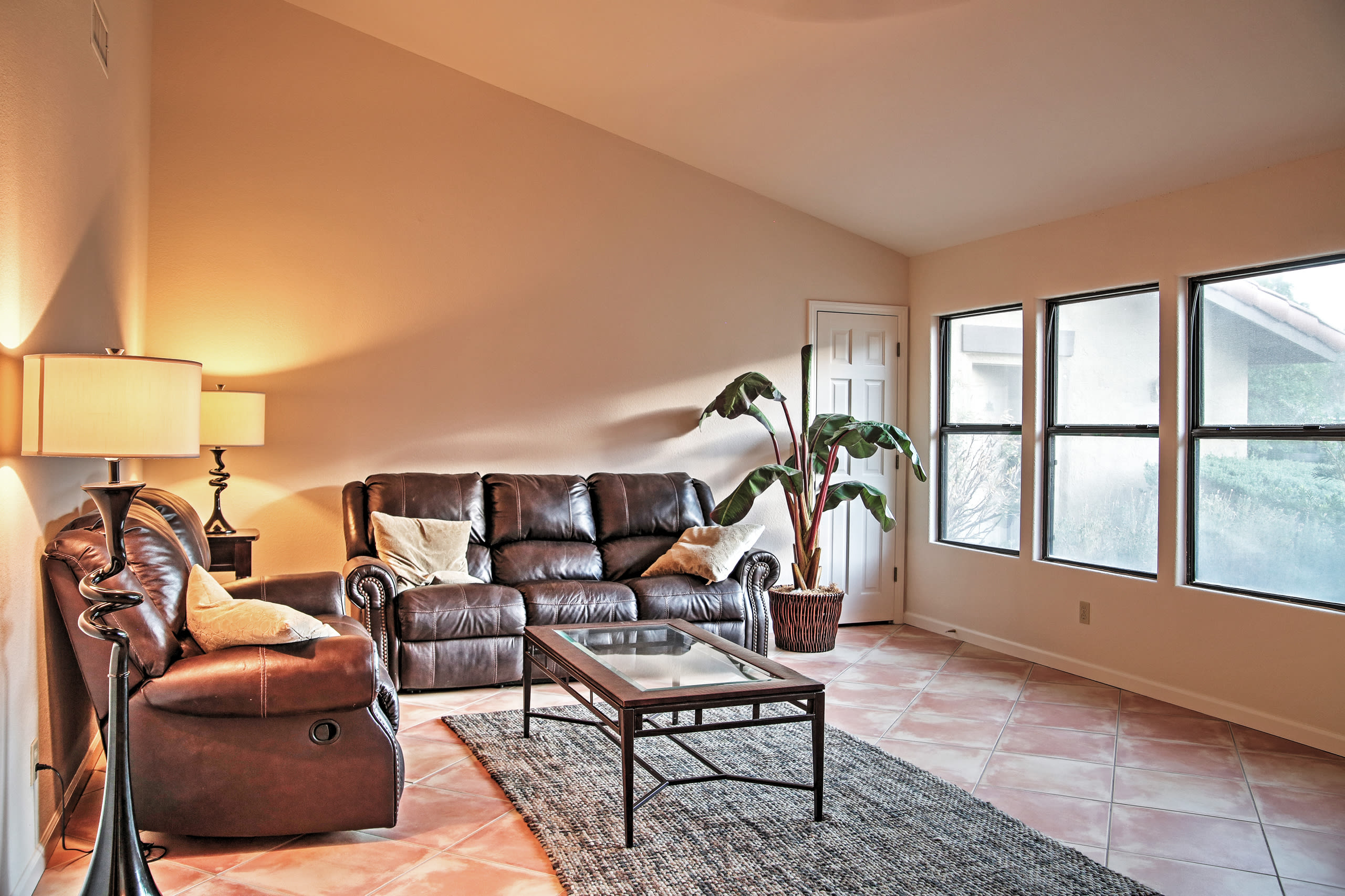 Relax on the cozy couches while enjoying beautiful views of the golf course.