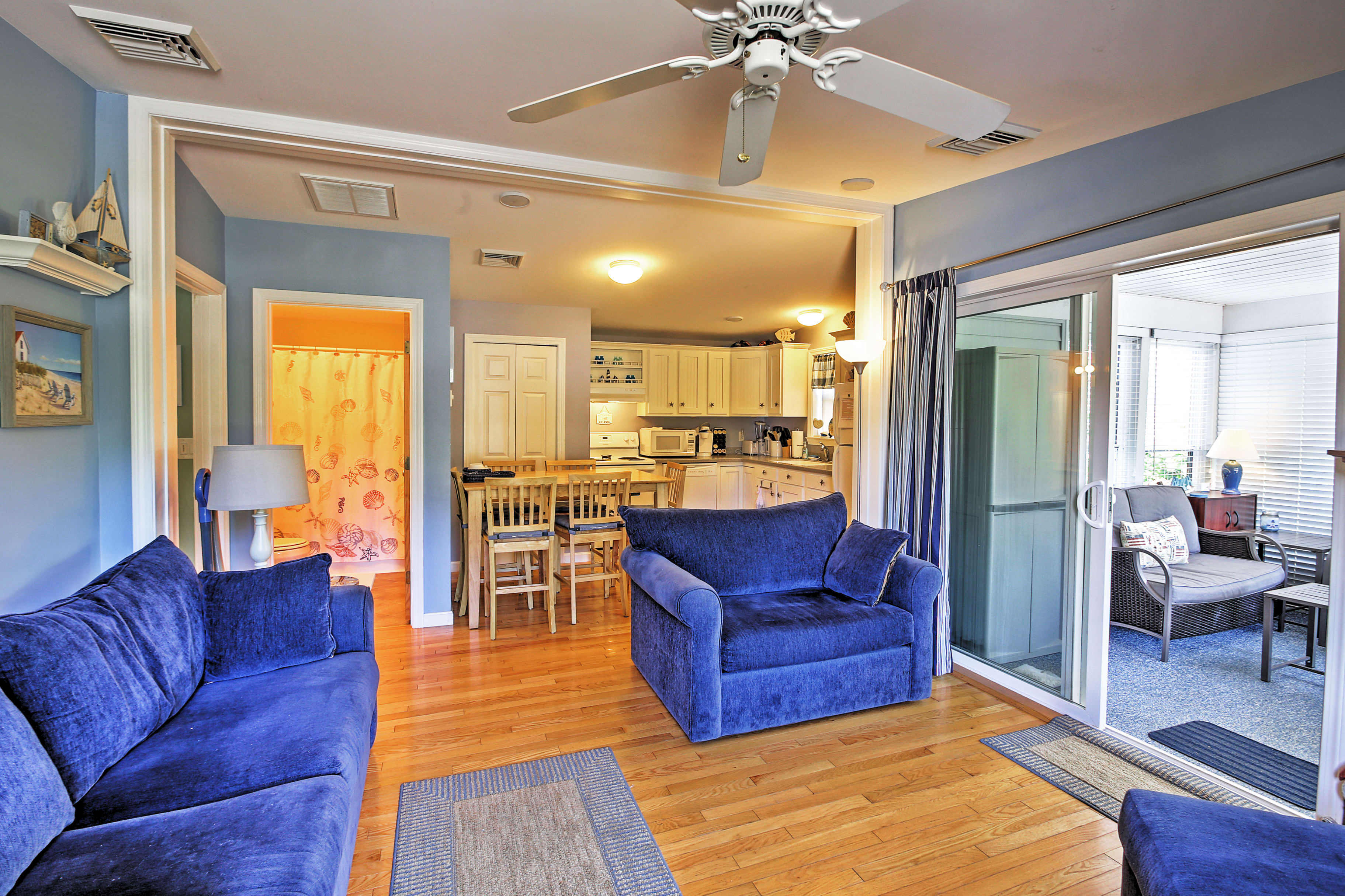 The living area offers plenty of plush seating for your whole group.