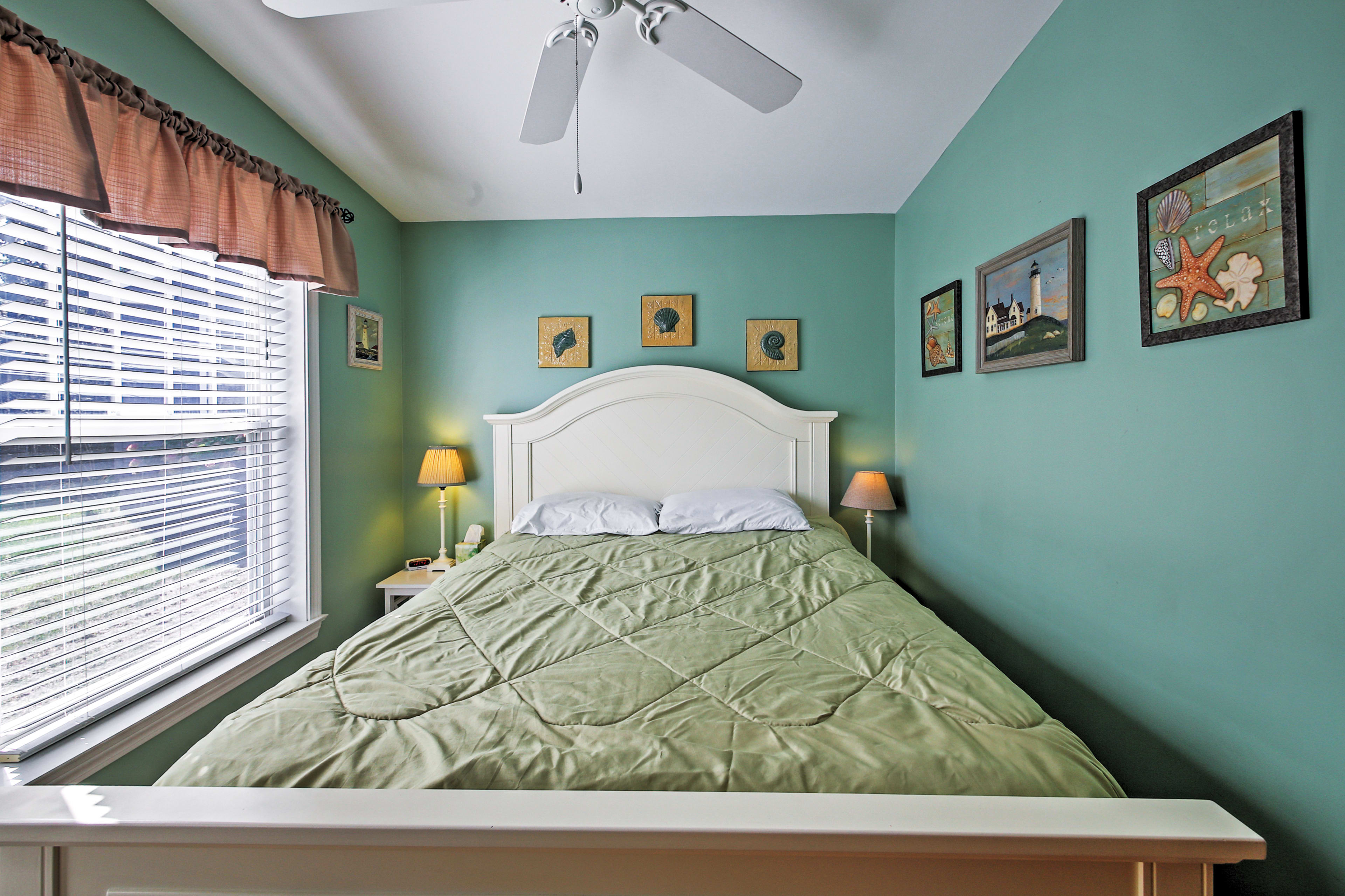 Enjoy a restful night on the queen bed in this bedroom.