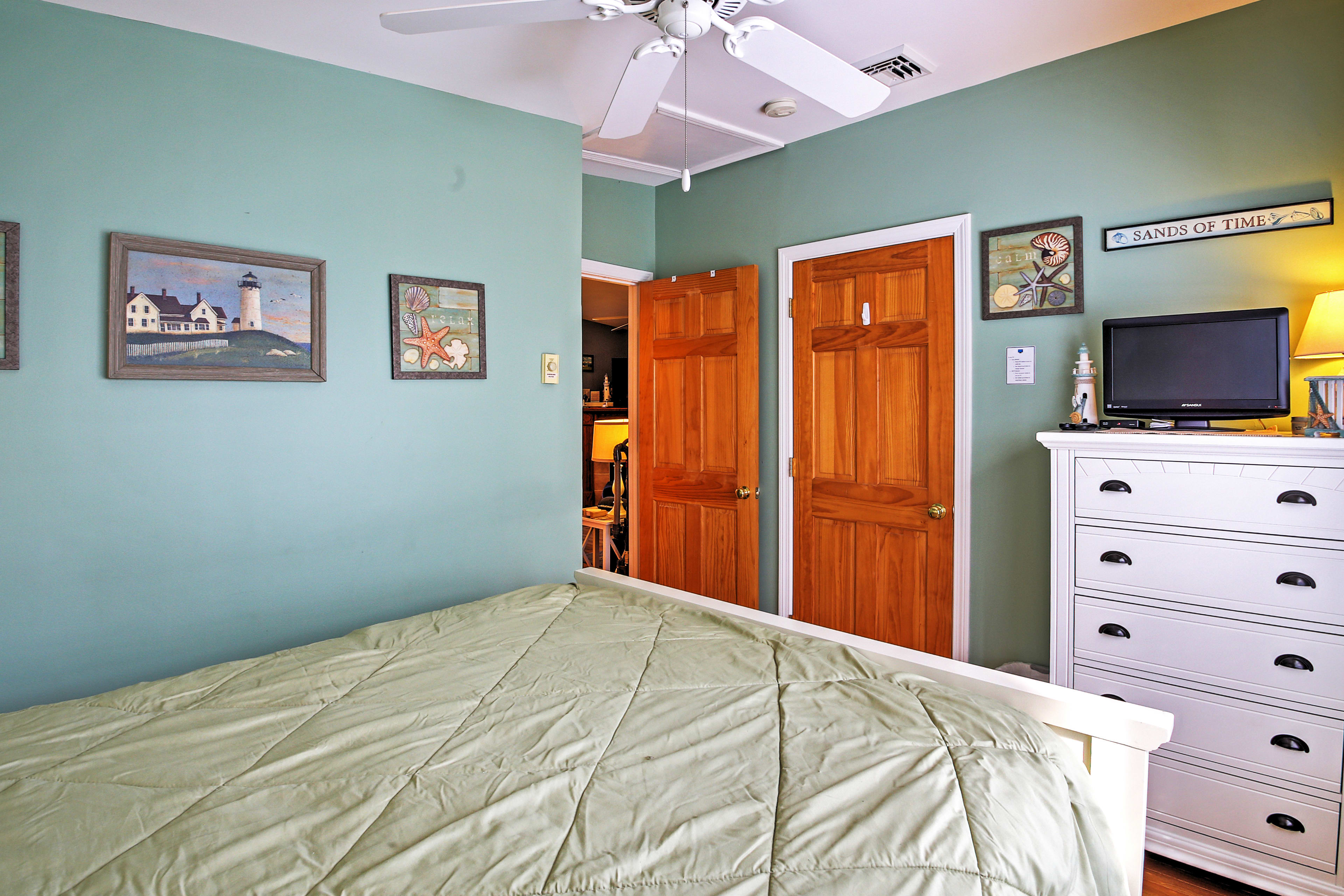 Wind down with a movie on the TV in the master bedroom.