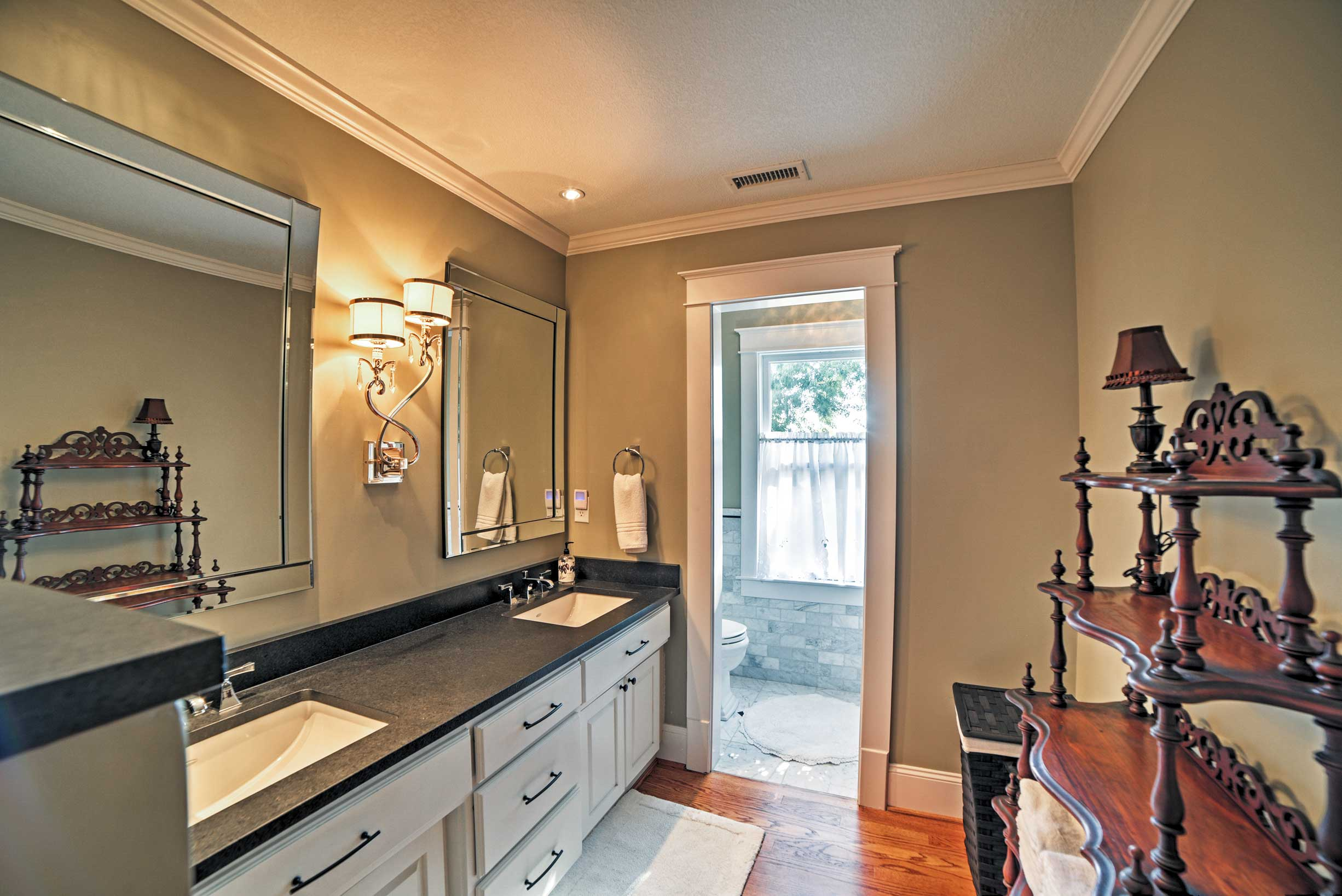 The bathroom includes double sinks.