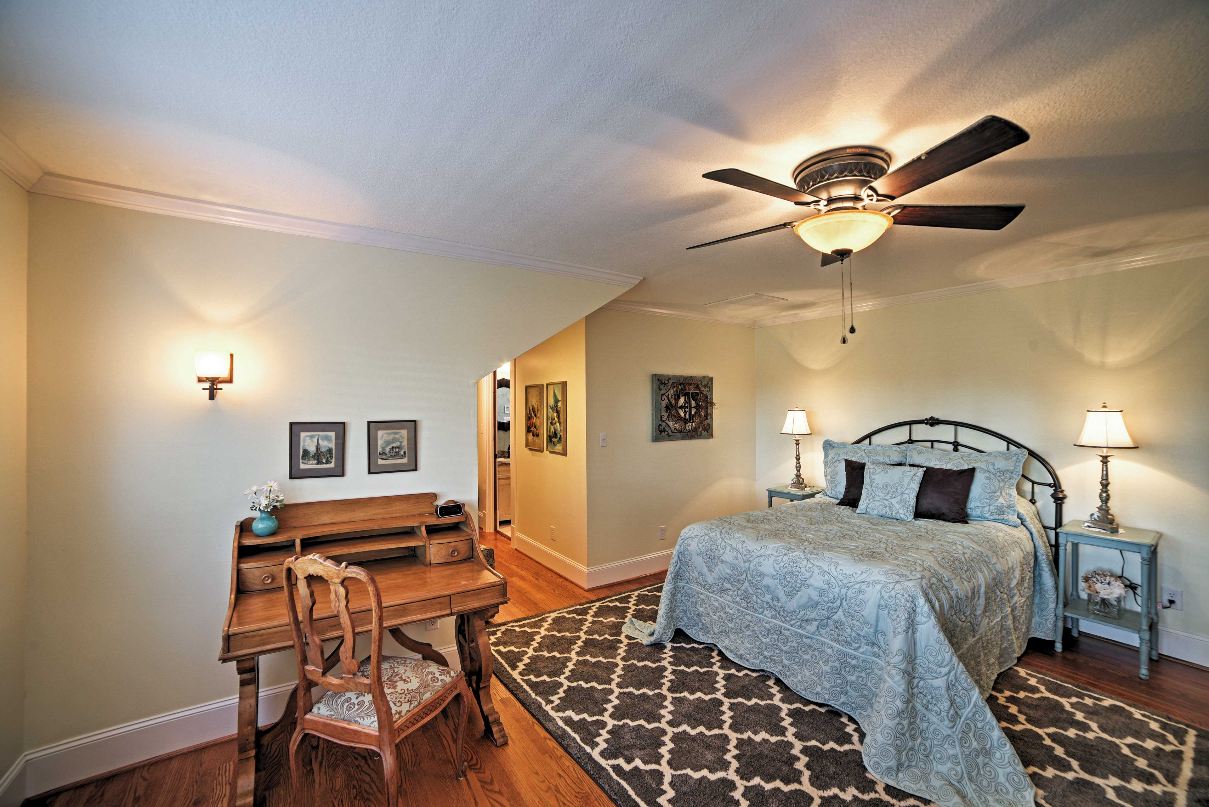 You'll find ample space to spread out and unwind in this lovely bedroom.