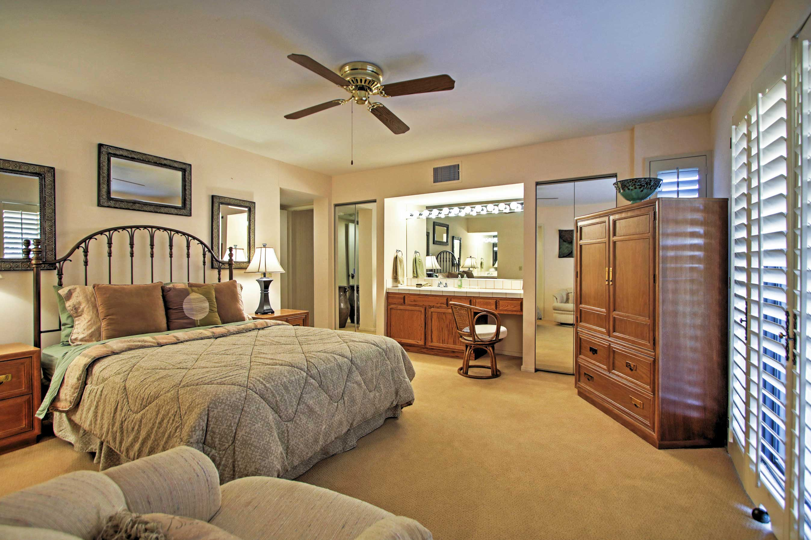 This master bedroom has a queen-sized bed.