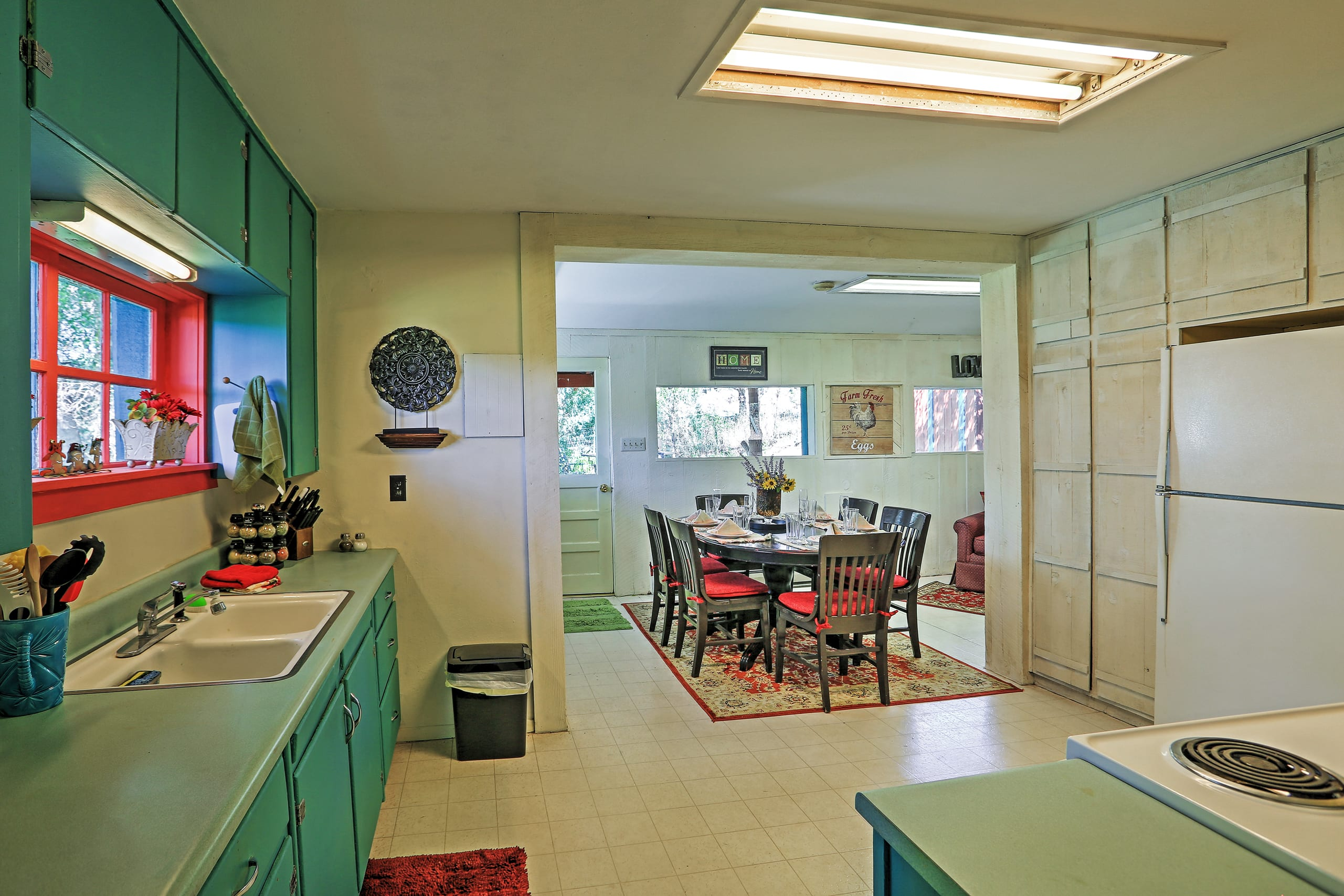 The kitchen comes to life with bright blue cabinetry!