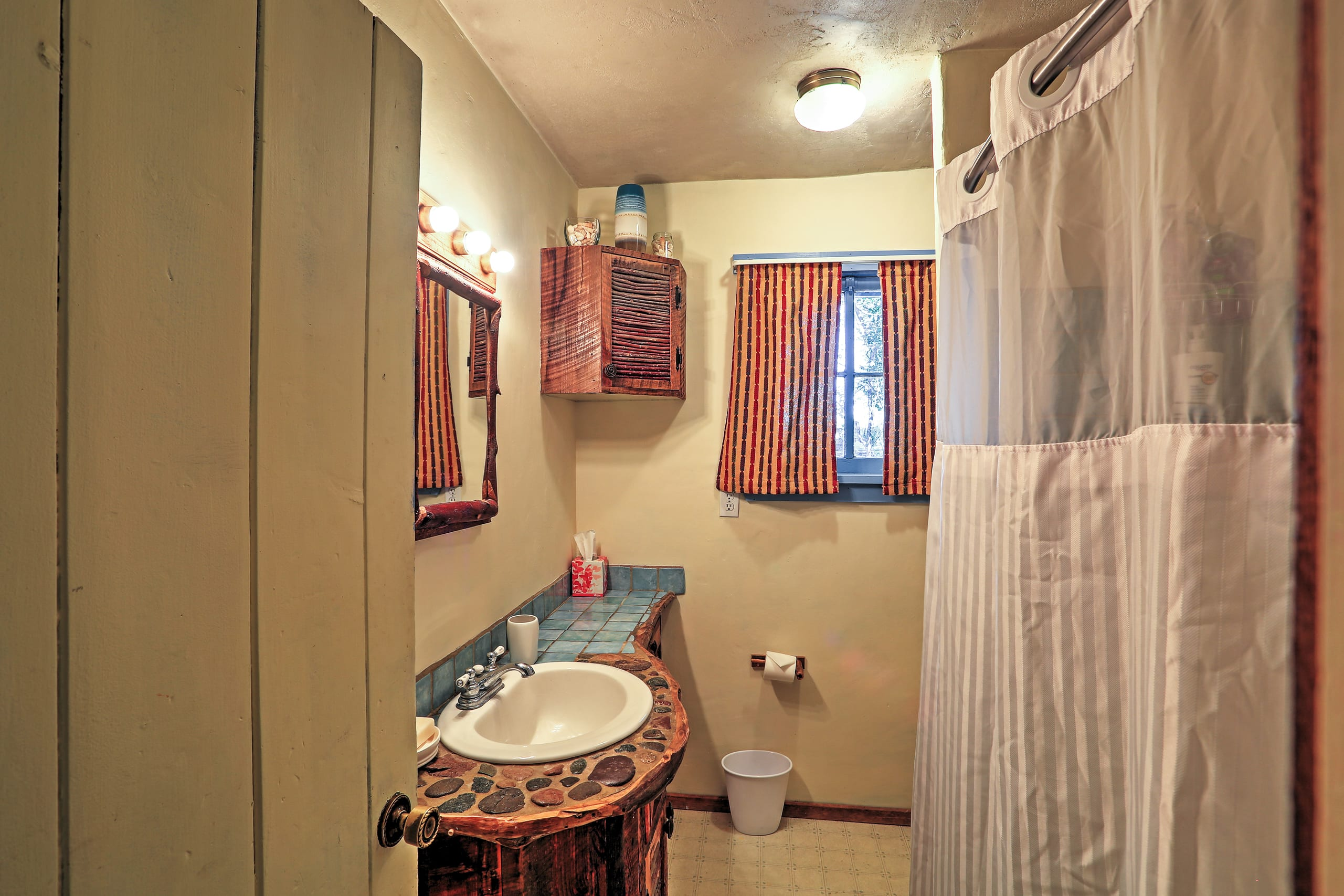 Rinse off in this full bathroom.