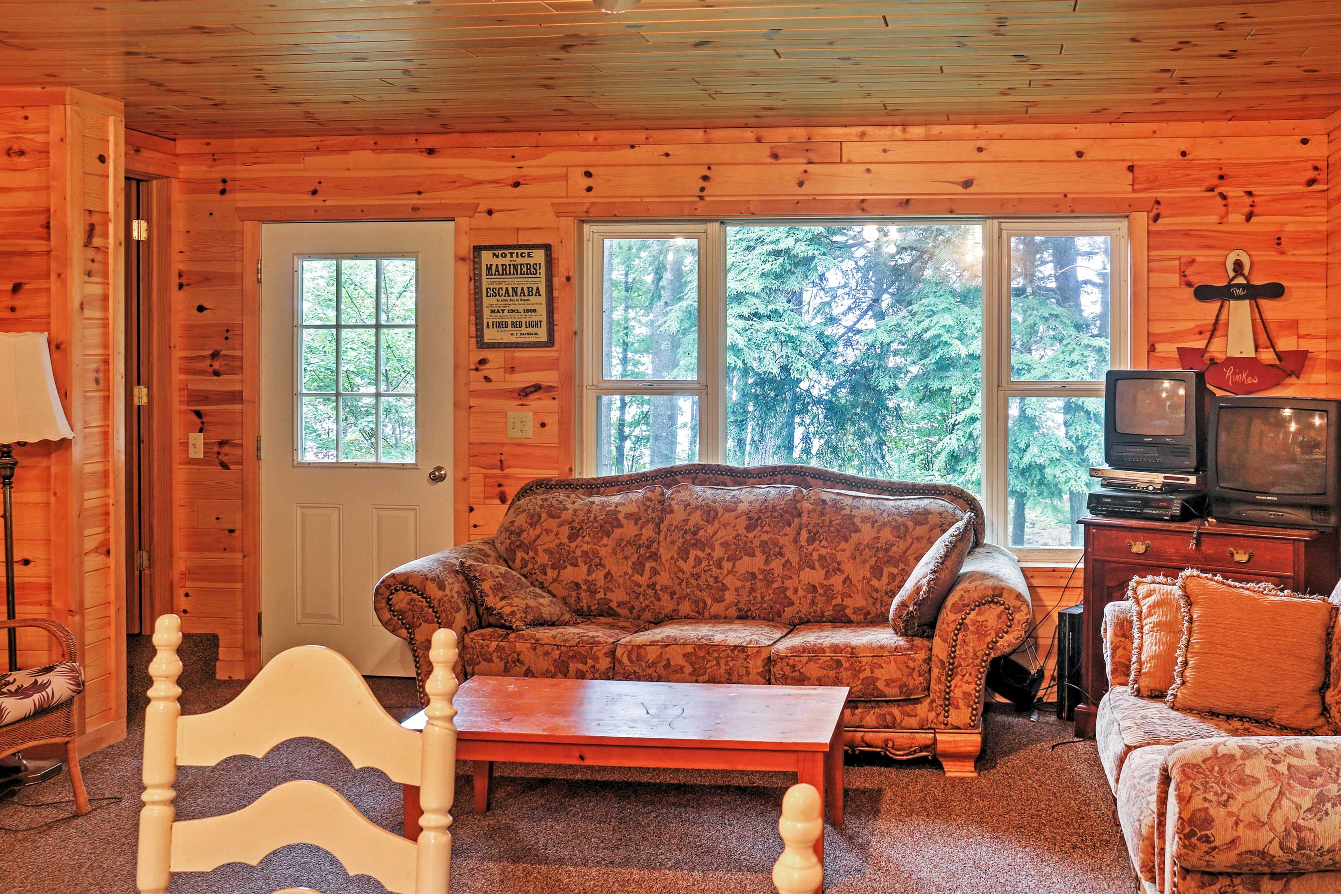 Enjoy stunning views of the lake from the open living room!