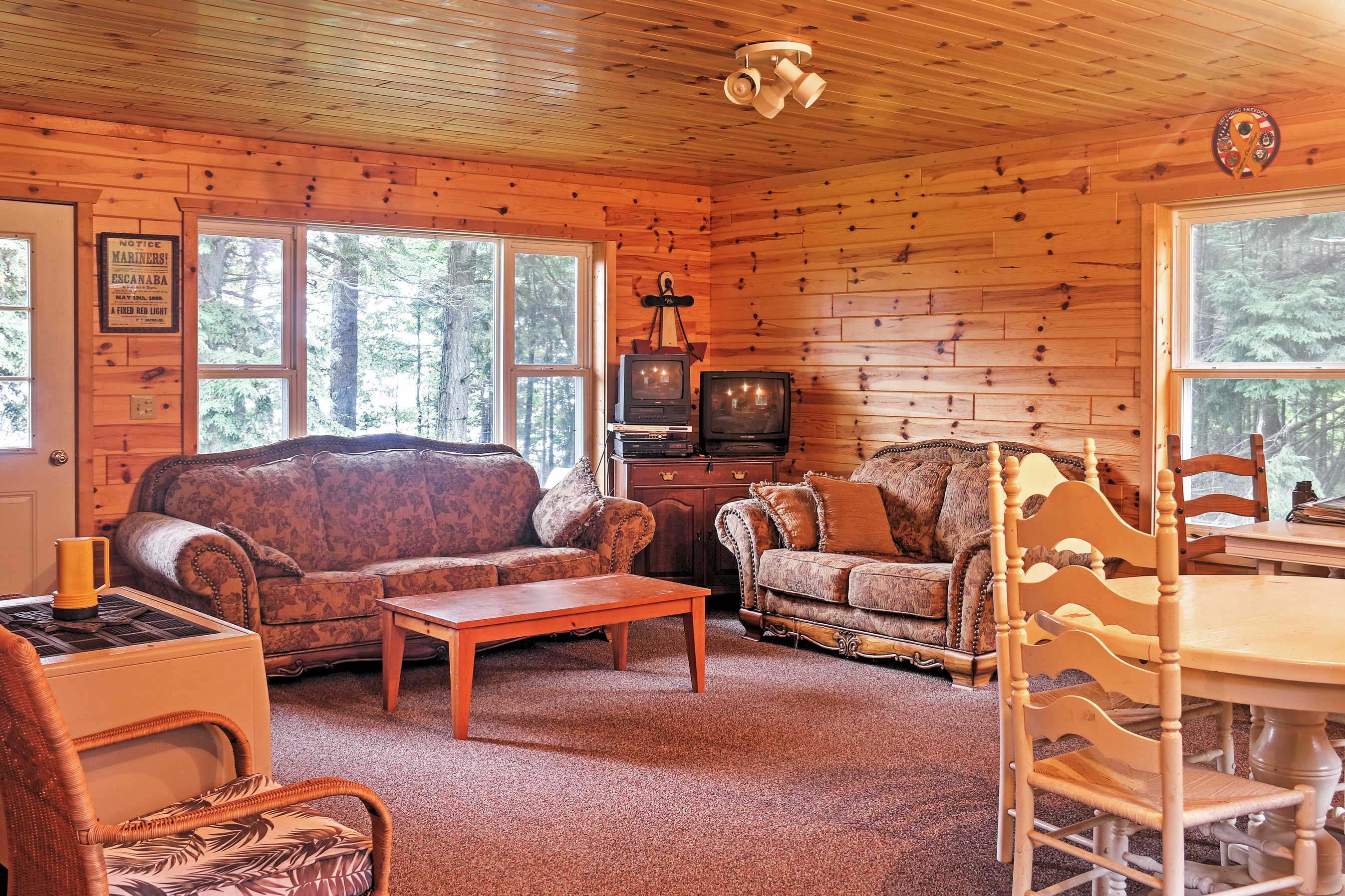 Sit back and relax on the cozy couches in the living area.