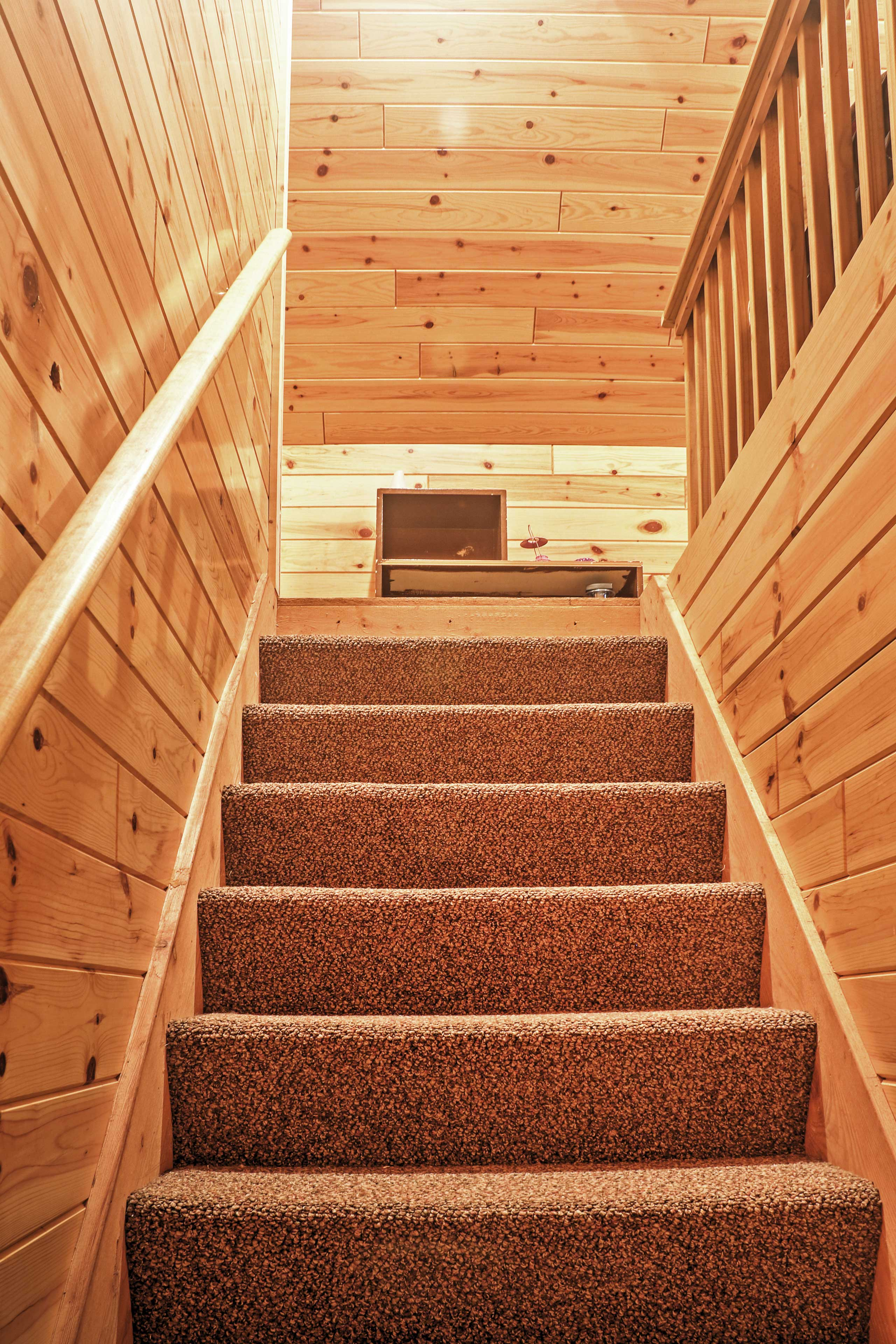 Head up the stairs to find the other 2 cape cod style sleeping areas.