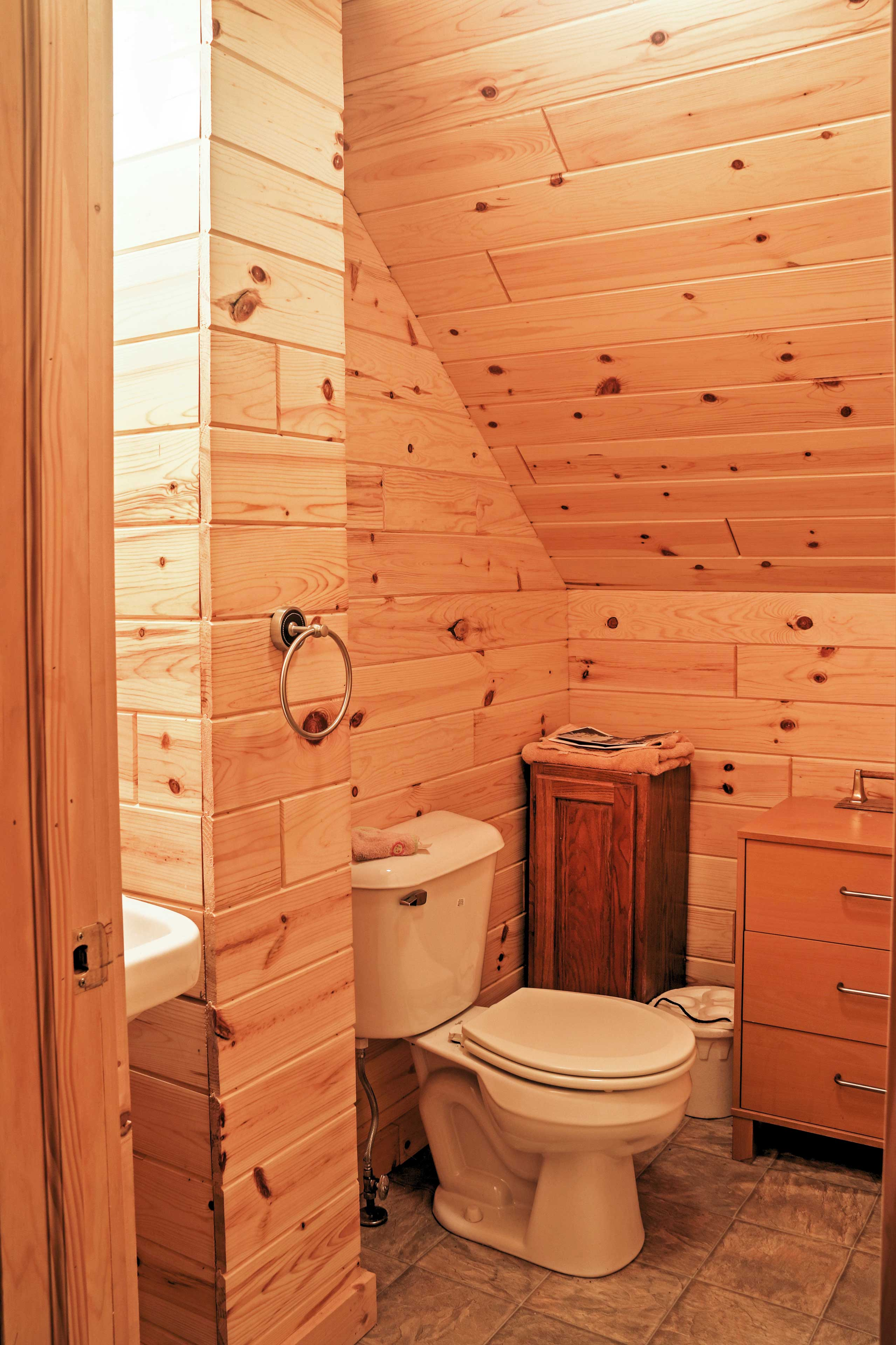 The 2 upstairs sleeping areas are separated by this quaint bathroom!