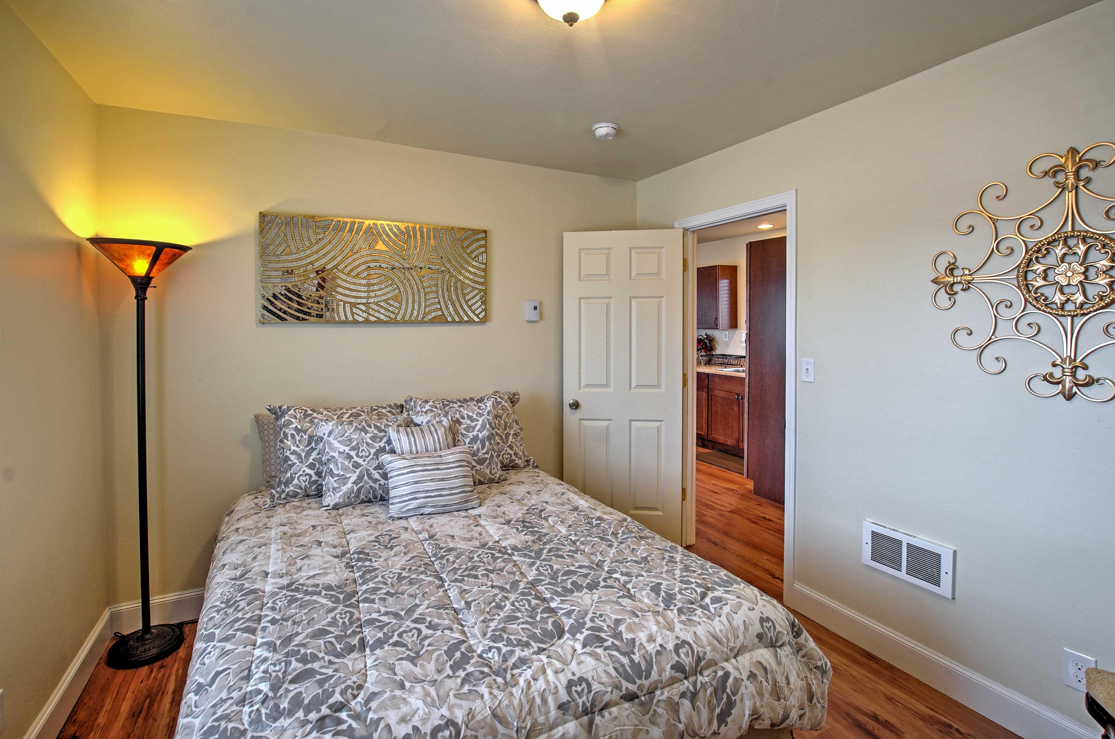 Bedroom 1 hosts a queen bed.