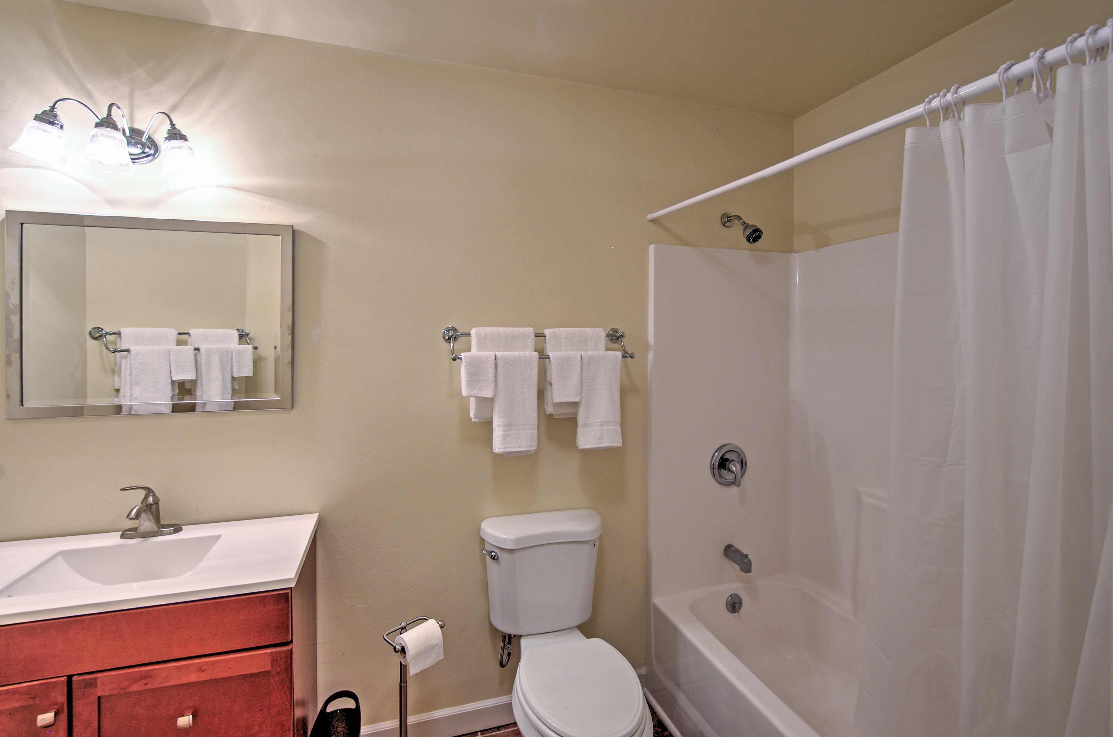 The bathroom has a full shower/tub combo.
