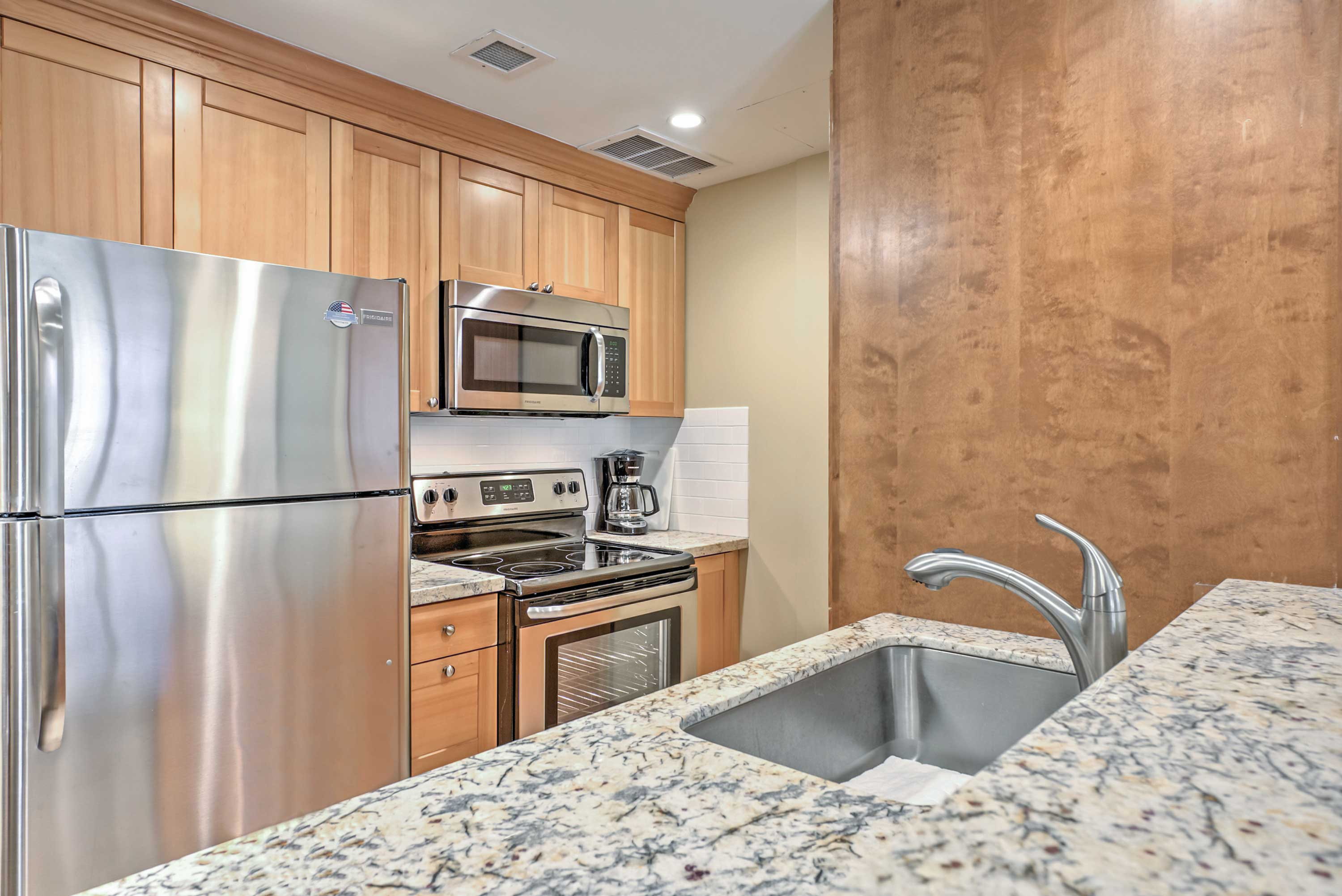 The spacious and fully equipped kitchen makes staying in and cooking easy!