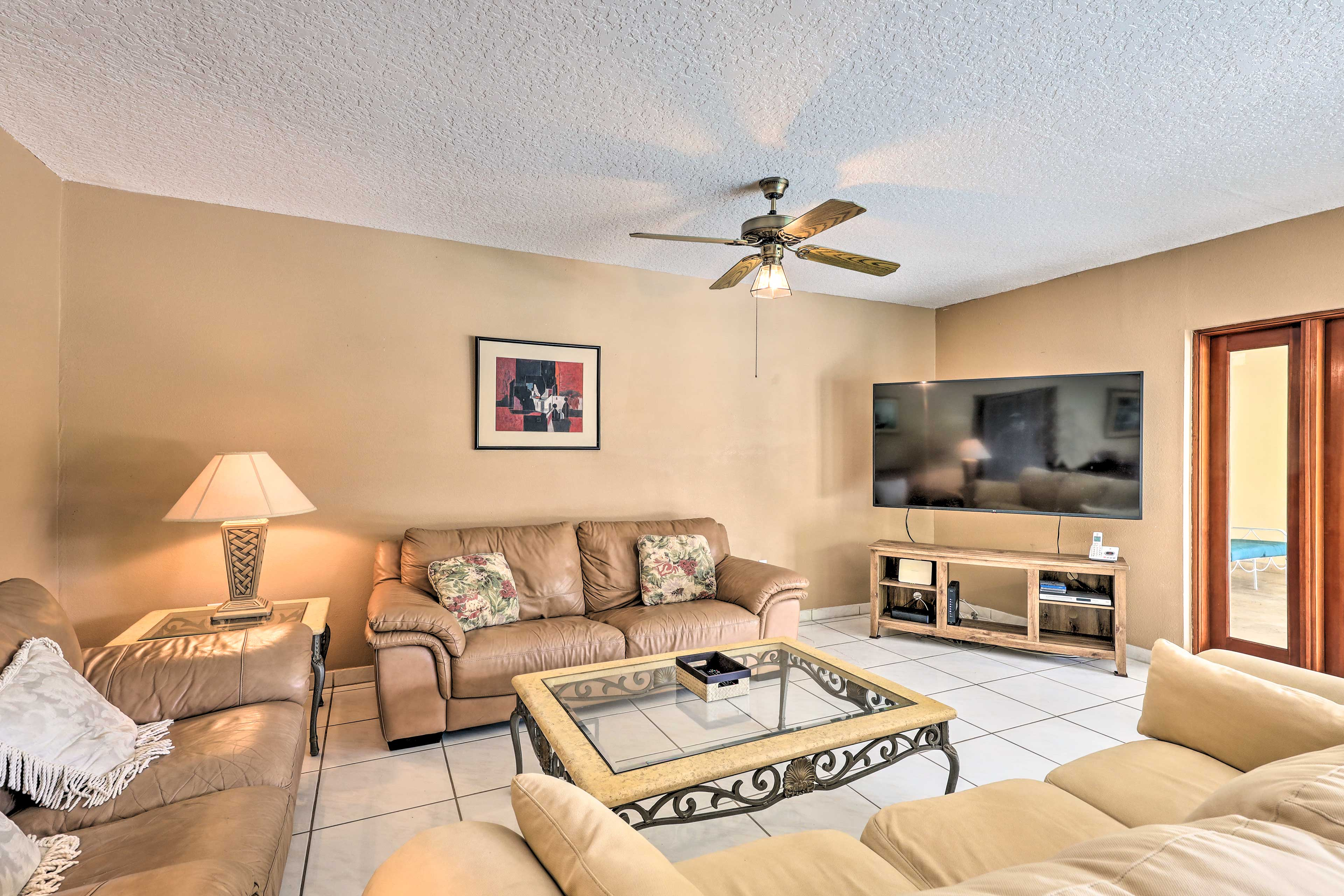 This home features a brand new 70-inch 4K TV for high-quality viewing!
