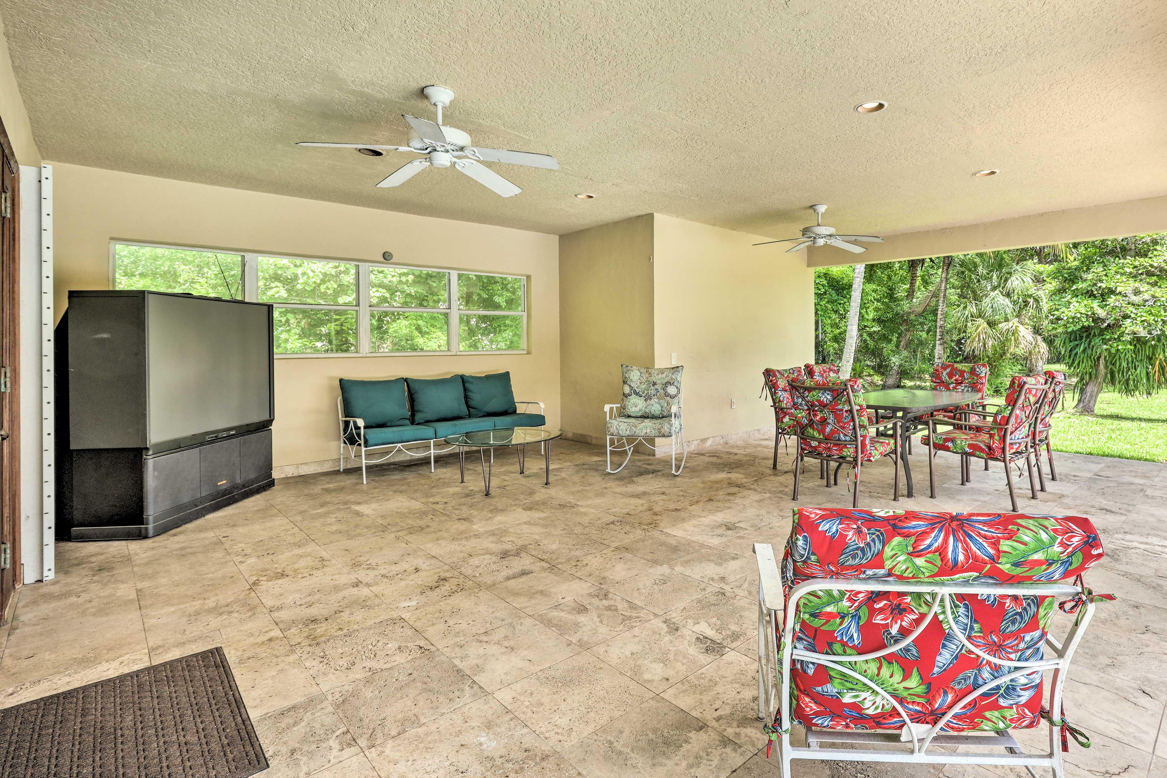 The spacious patio area has a TV.
