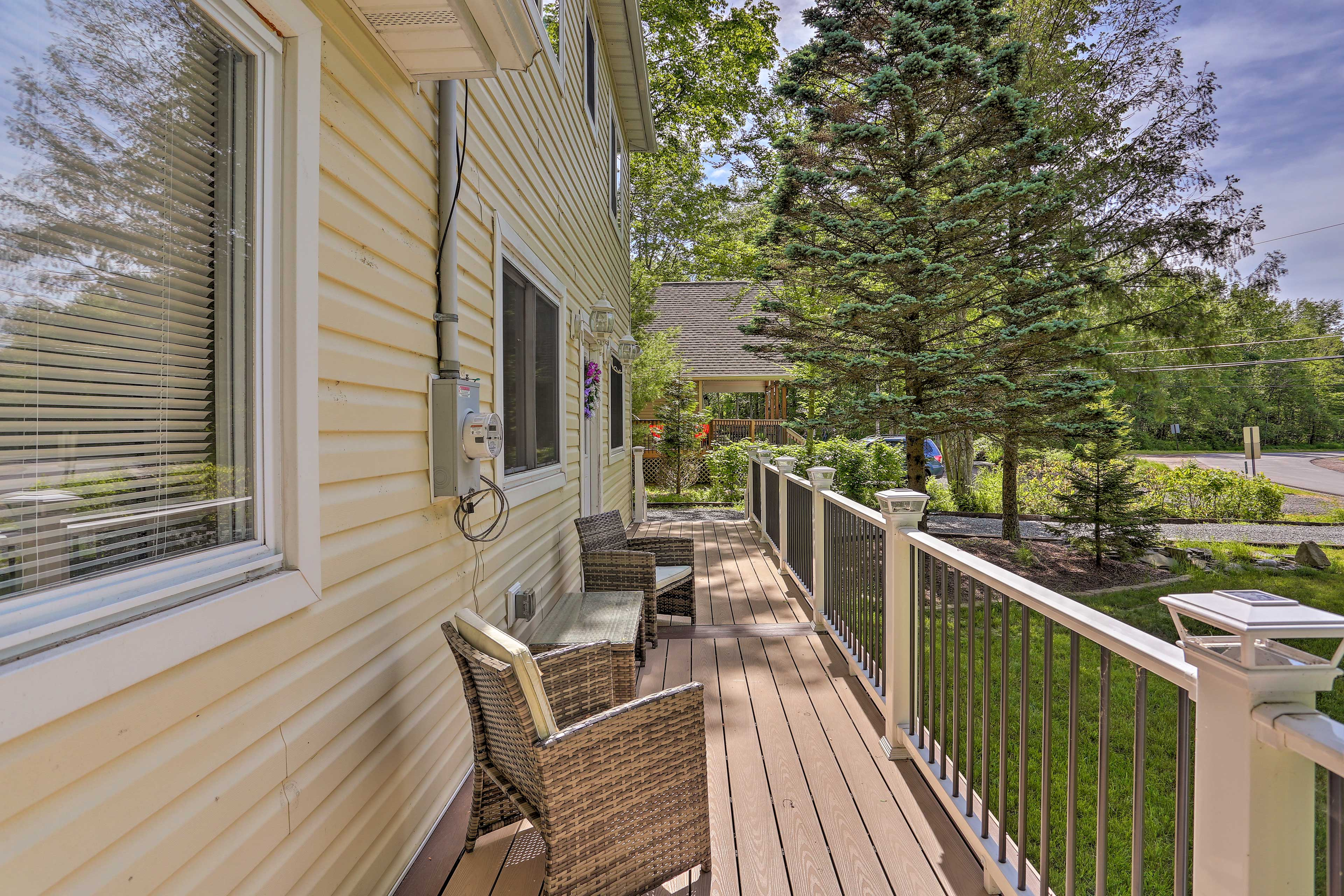 Admire nature's beauty from the spacious front porch!