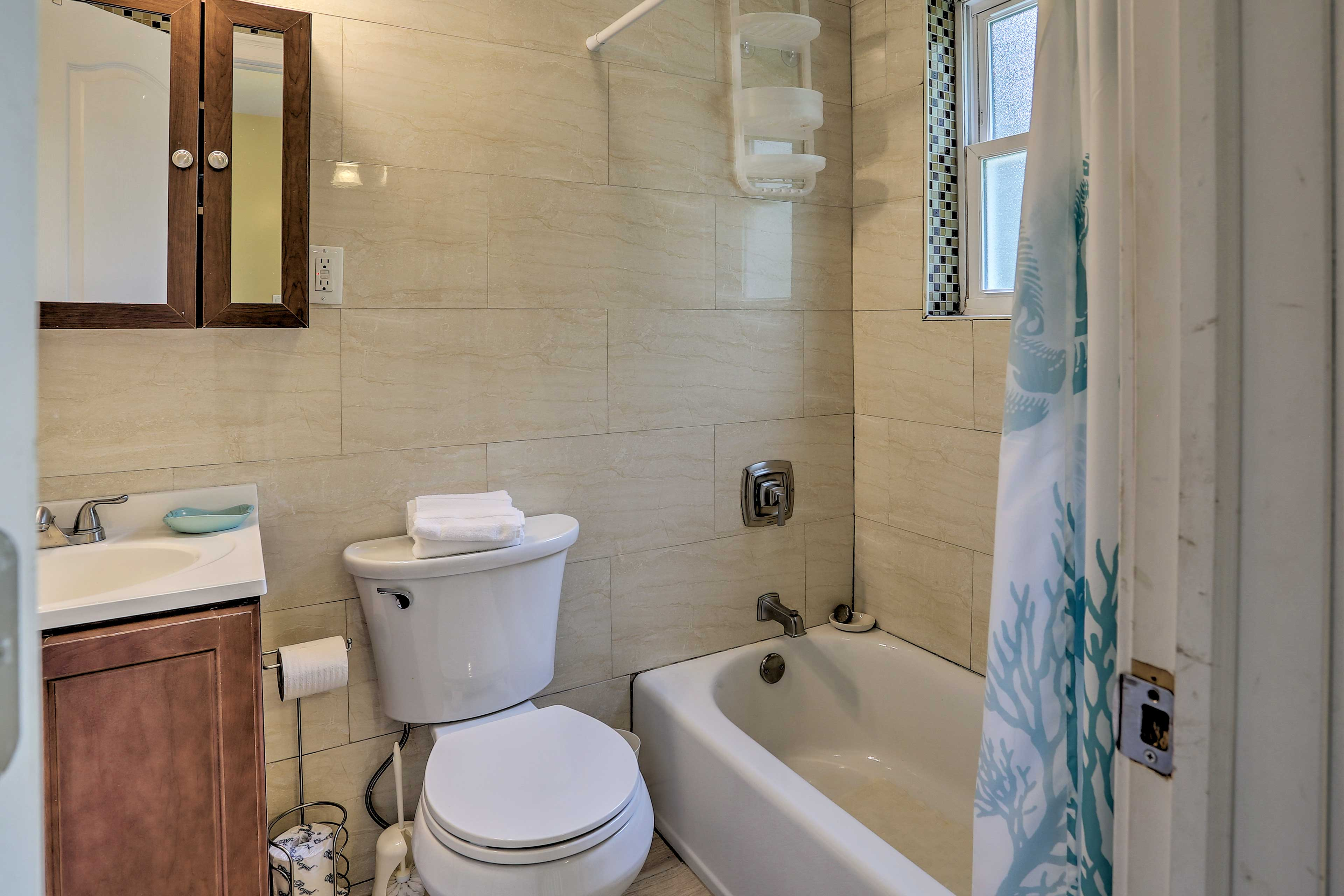 A shower/tub combo highlights this bathroom.