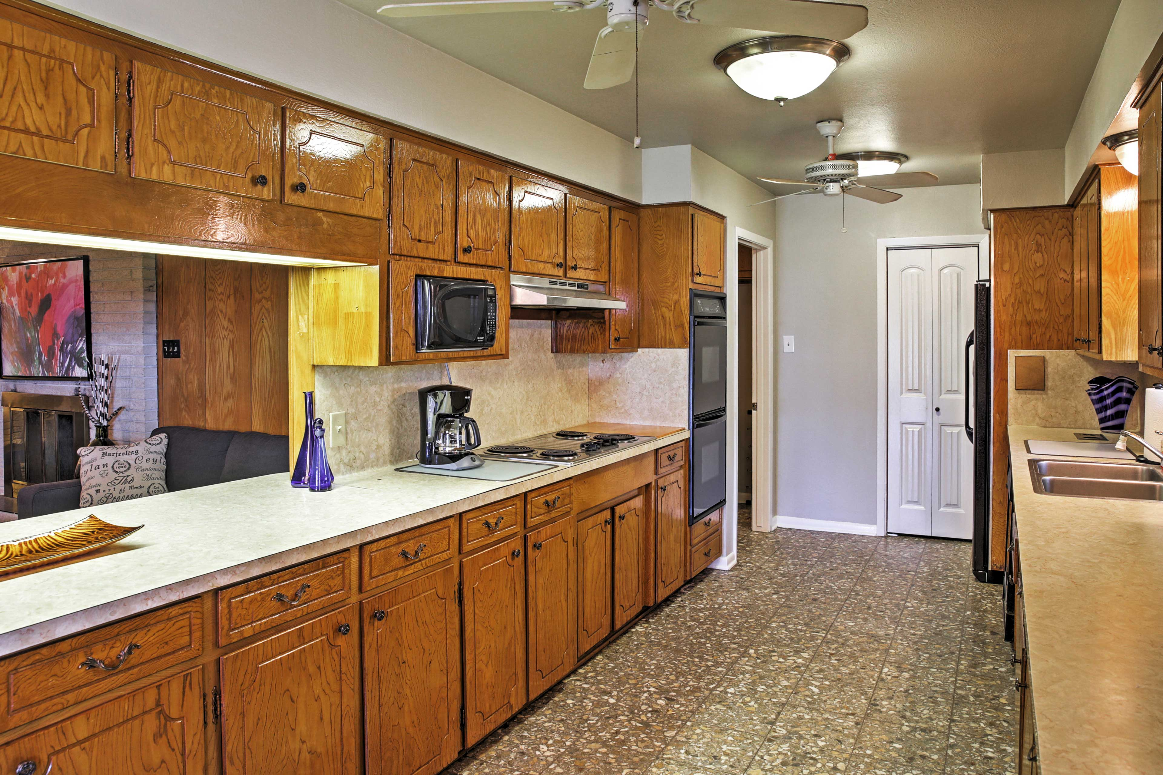 The kitchen's pass through window allows the chef to socialize while cooking!