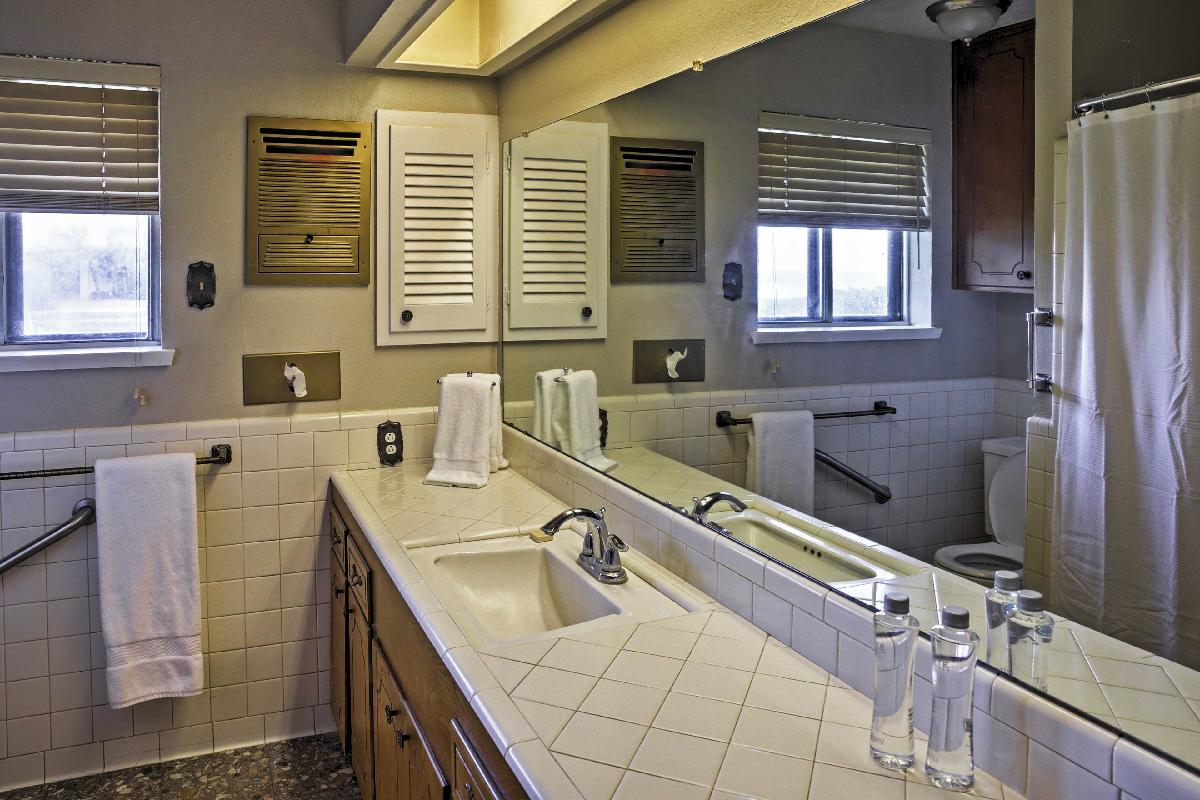 This bathroom provides enough space for many companions to get ready in the mornings!