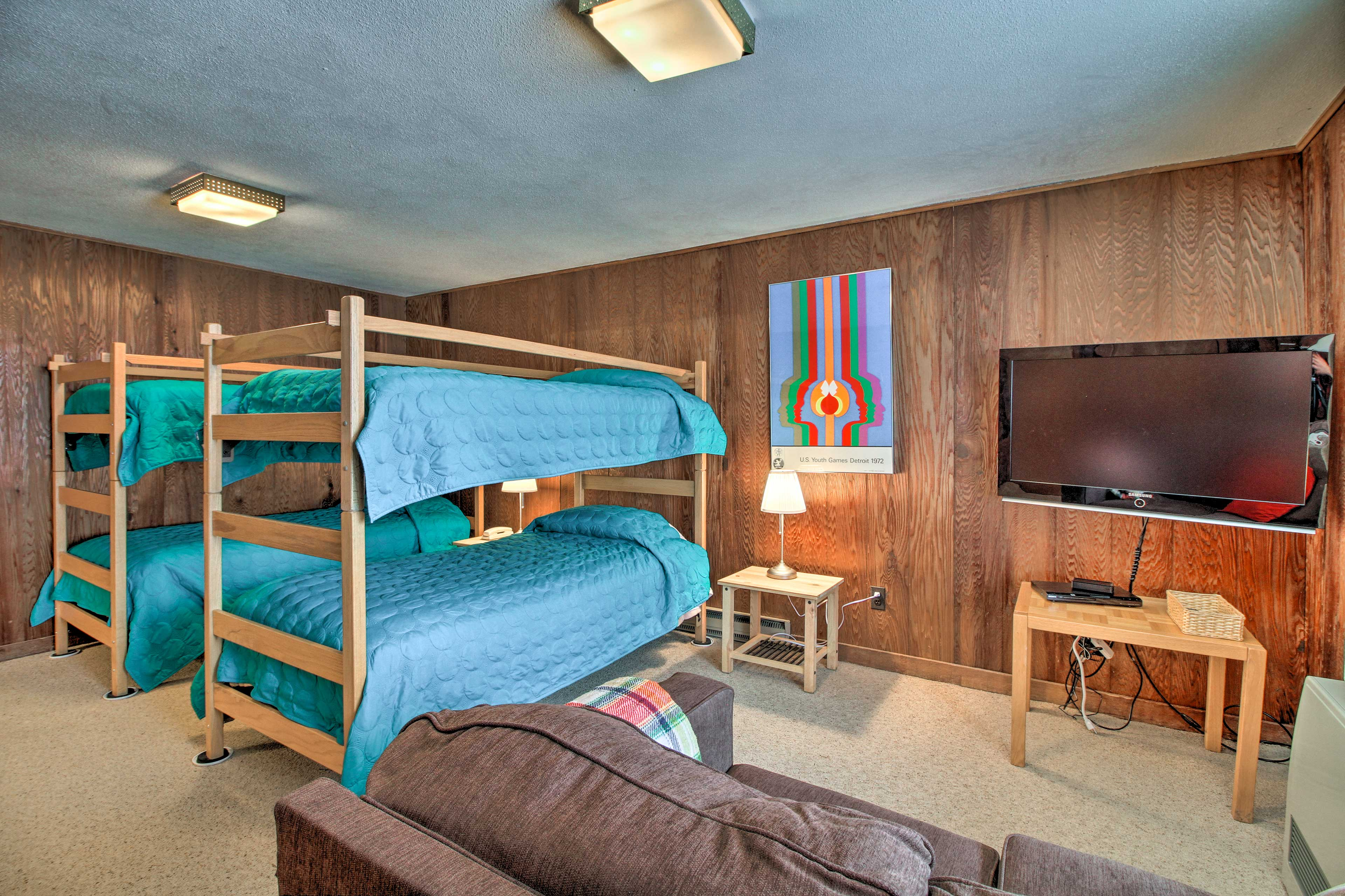 This room has a set of twin-over-twin bunk beds and a TV.
