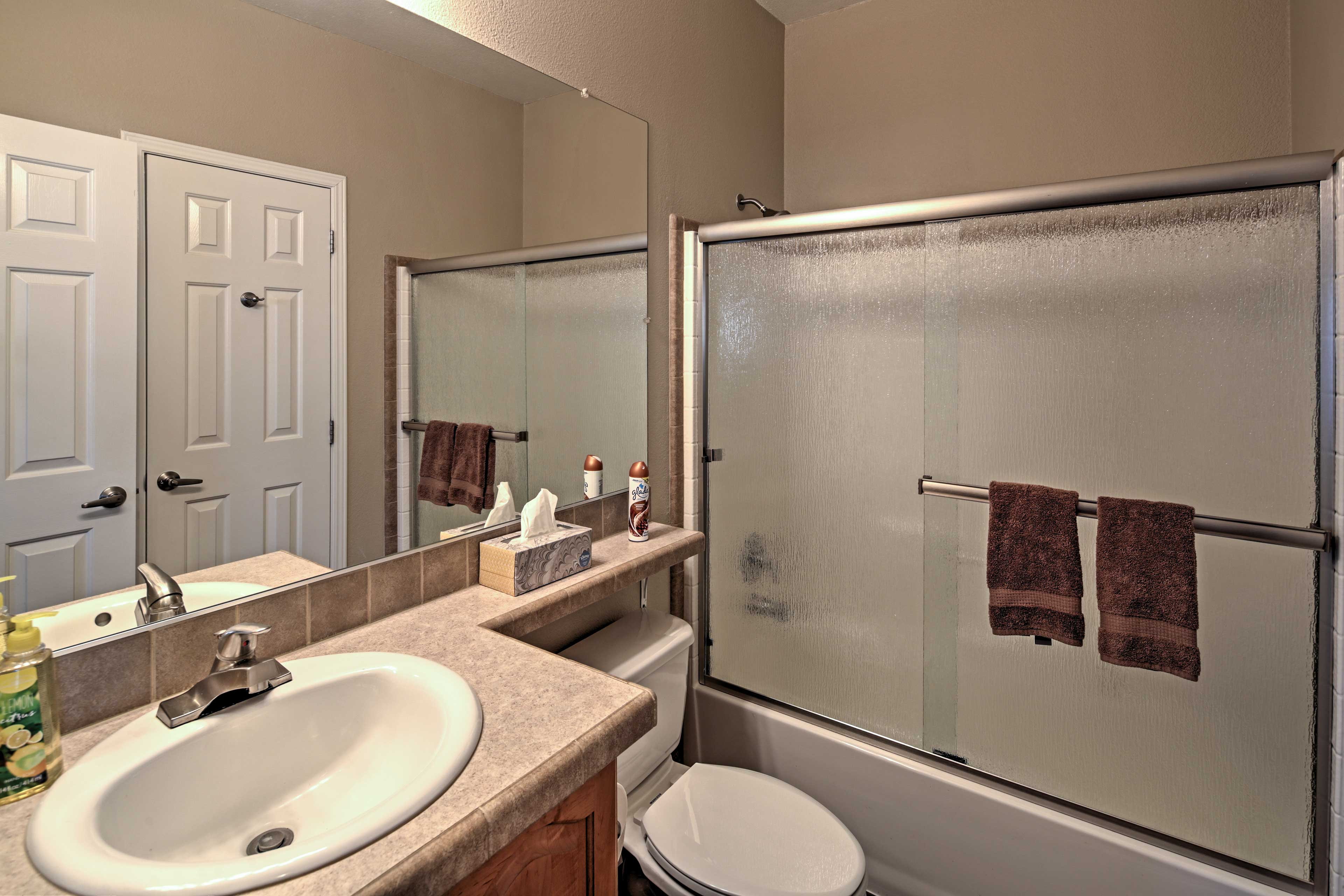 This full bathroom is complete with a shower/tub combo.