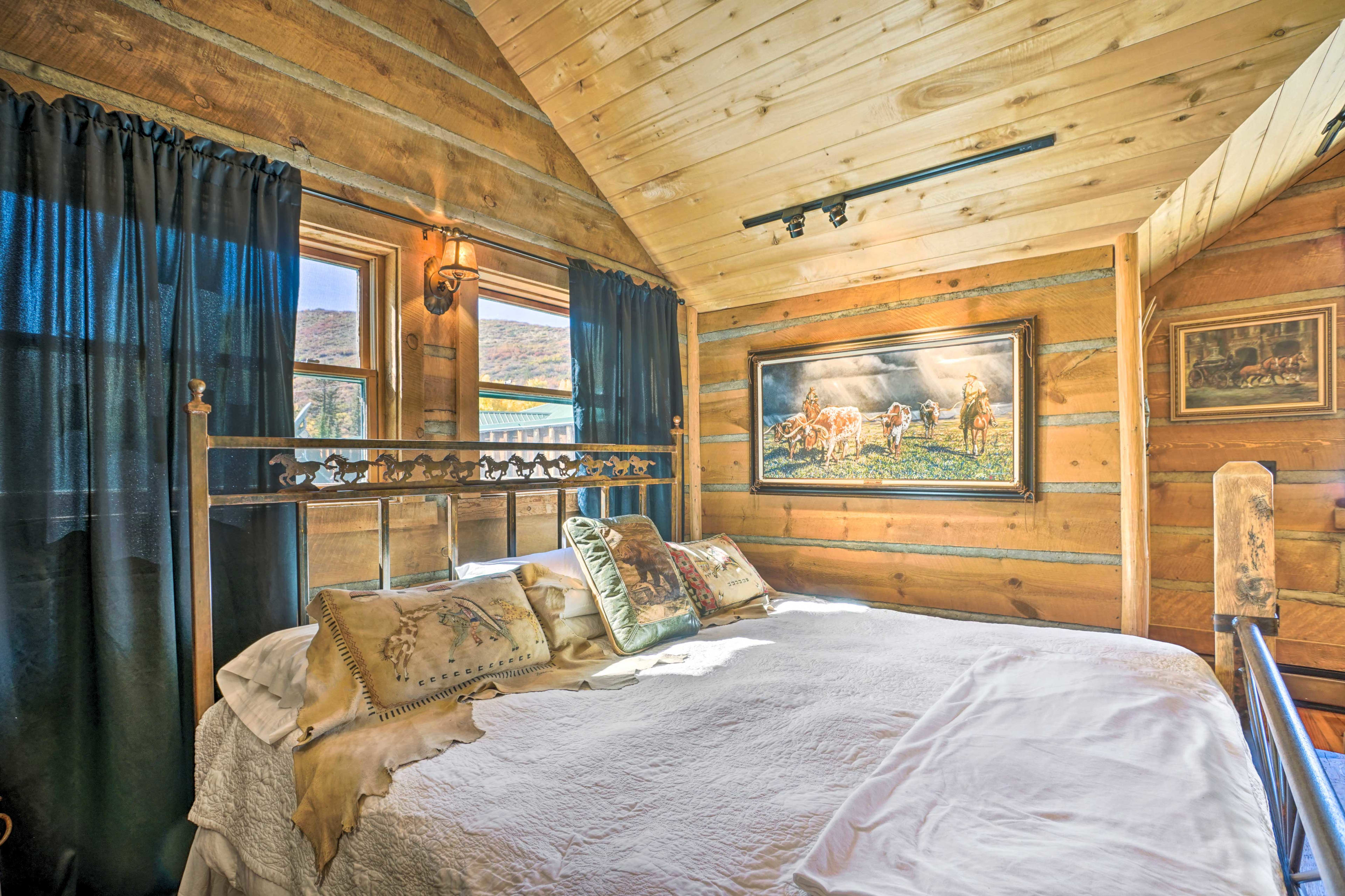 Two guests can share this luxury king bed.