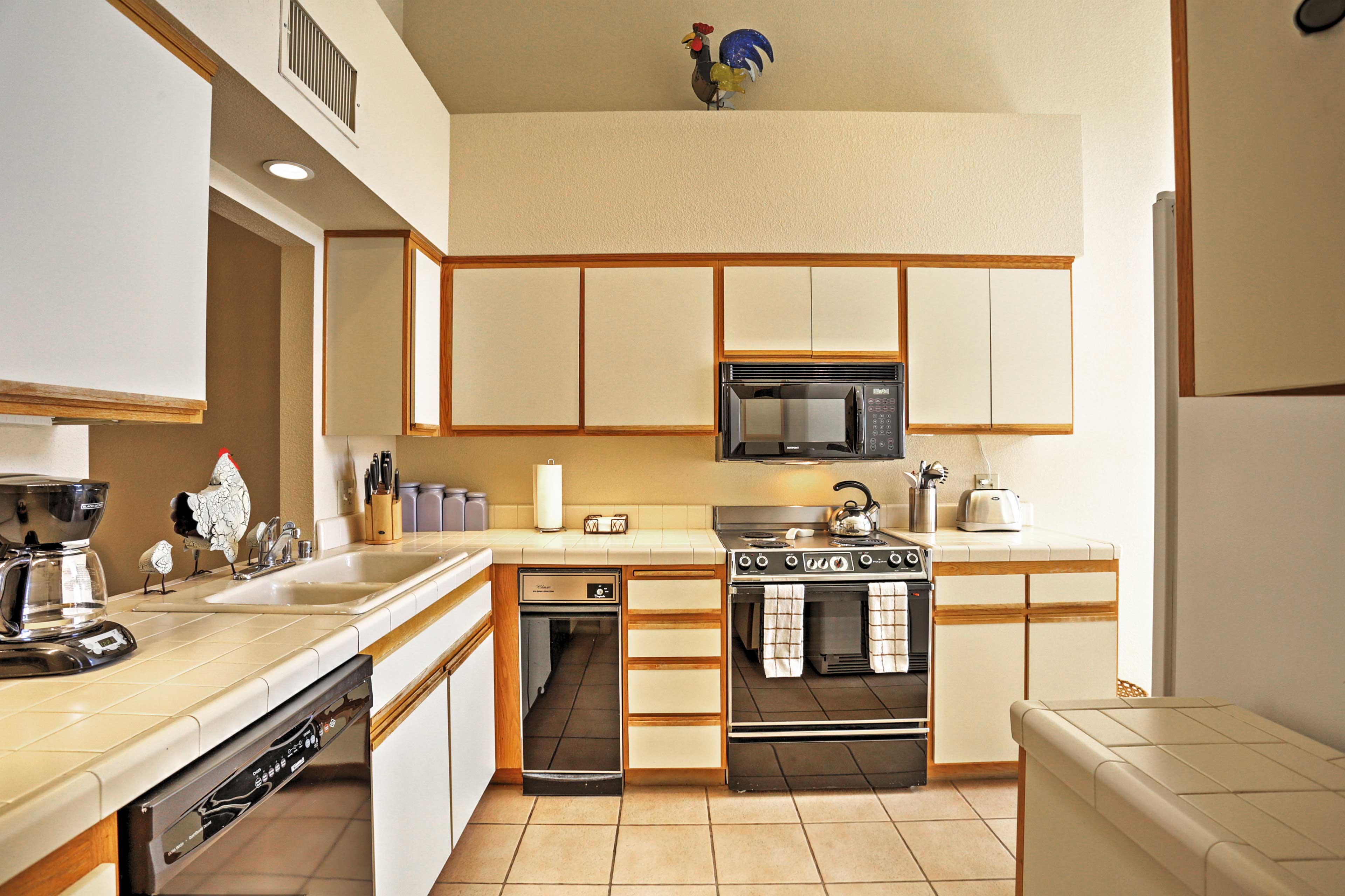 The fully equipped kitchen is perfect for preparing tasty treats.