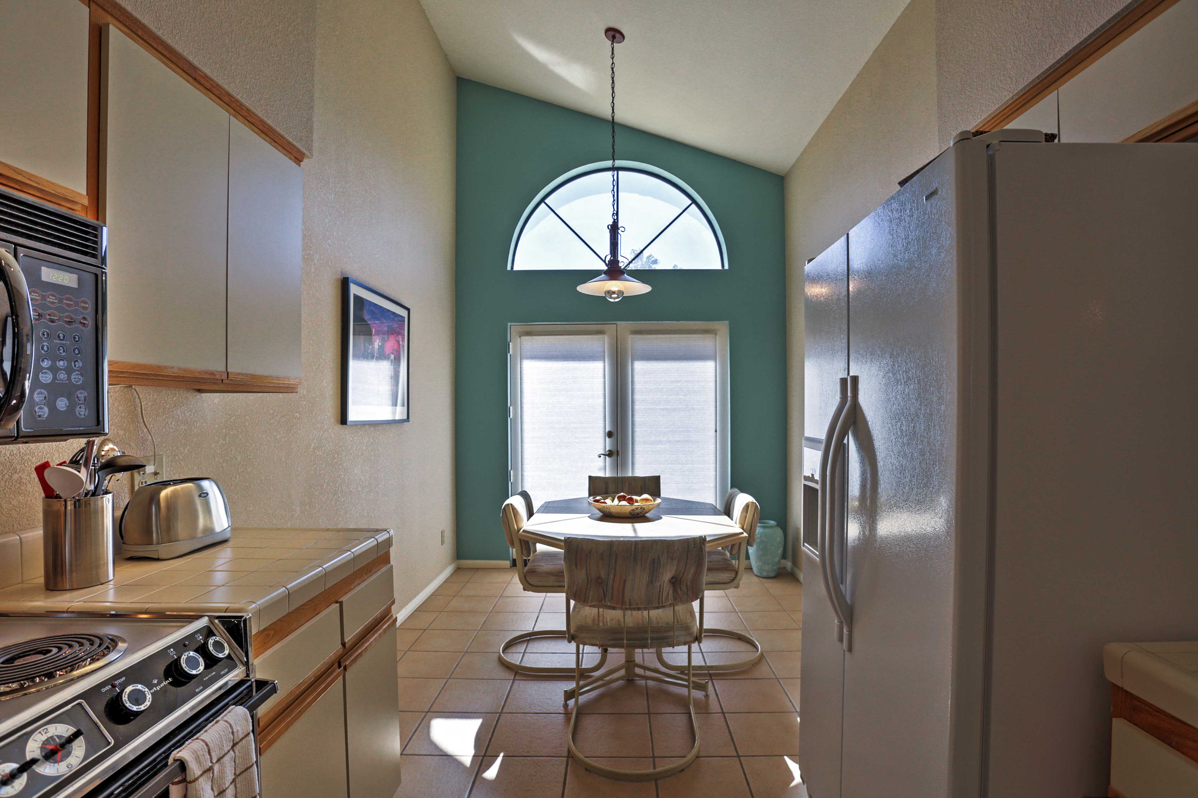 The kitchen also has a sunny nook for the kitchen table.